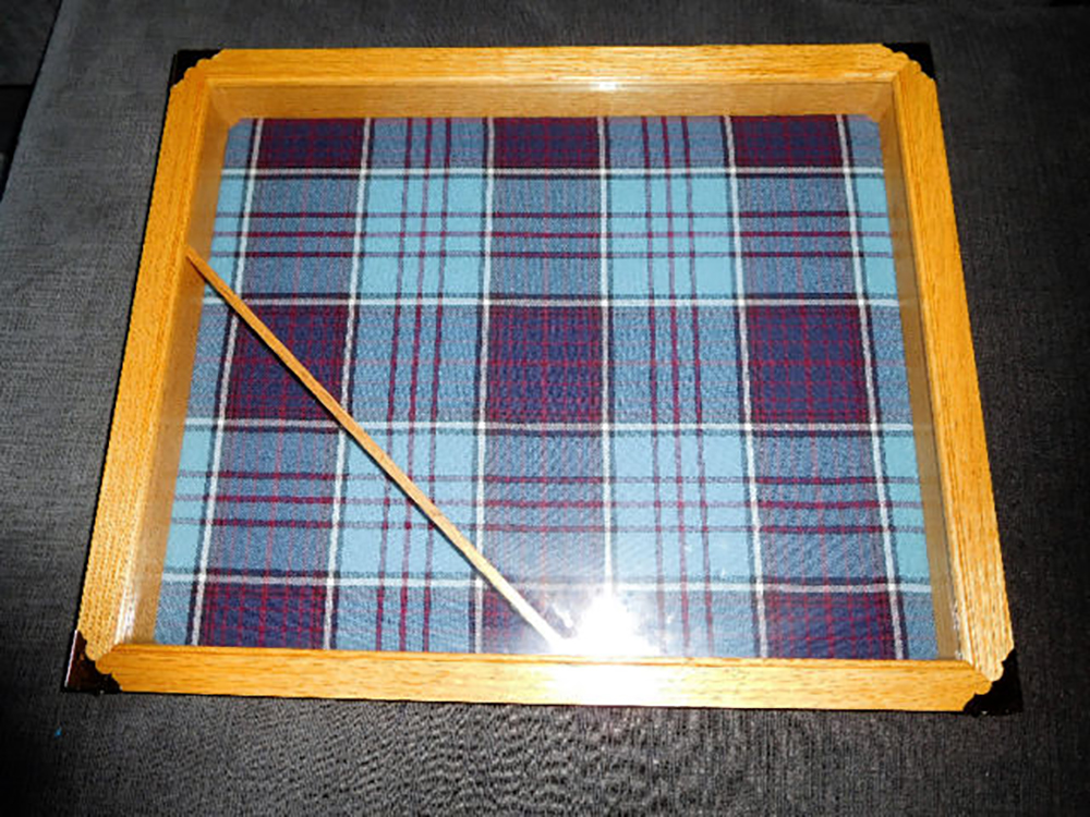 Craftspersons often incorporate the Royal Canadian Air Force tartan into their projects because its muted tones are very pleasing to the eye. IMAGE: http://www.kijiji.ca/v-buy-sell-other/dartmouth/rcaf-shadow-box/1247707887?enableSearchNavigationFlag=true