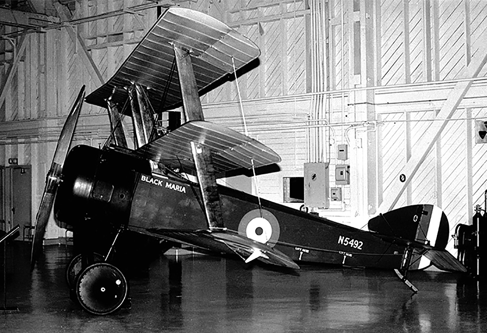 A photograph of the Sopwith Triplane taken in the pre-Second World War hangar that housed the National Aeronautical Collection in 1967. The Triplane was a successful attempt to produce a fighter with outstanding manœuvrability and excellent visibility for the pilot. Records of procurement are very confused, but the Royal Naval Air Service received all of the small number of Triplanes available. Even though the Triplane remained in front-line service for less than a year, it was so successful that it inspired several German triplane designs. Only 150 Sopwith Triplanes were built. The all-Canadian B Flight of No. 10 (Naval) Squadron, equipped with Triplanes, downed 87 enemy aircraft between May and July 1917. Called the Black Flight because of the black markings of their airplanes, their aircraft were named: Black Maria, Black Sheep, Black Prince, Black Roger, and Black Death. Black Maria was the Triplane flown by Air Vice Marshal Raymond Collishaw, the great Canadian ace of the First World War. PHOTO/TEXT: Canada Aviation and Space Museum