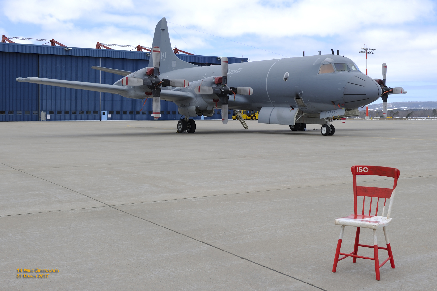 "The Kings County Museum's ""Canada 150 Chair"" was photographed by a 14 Wing Greenwood, Nova Scotia, imagery technician on the tarmac at 14 Wing. In the background is a CP-140 Aurora long-range patrol aircraft. PHOTO:  Corporal Karen Neate"