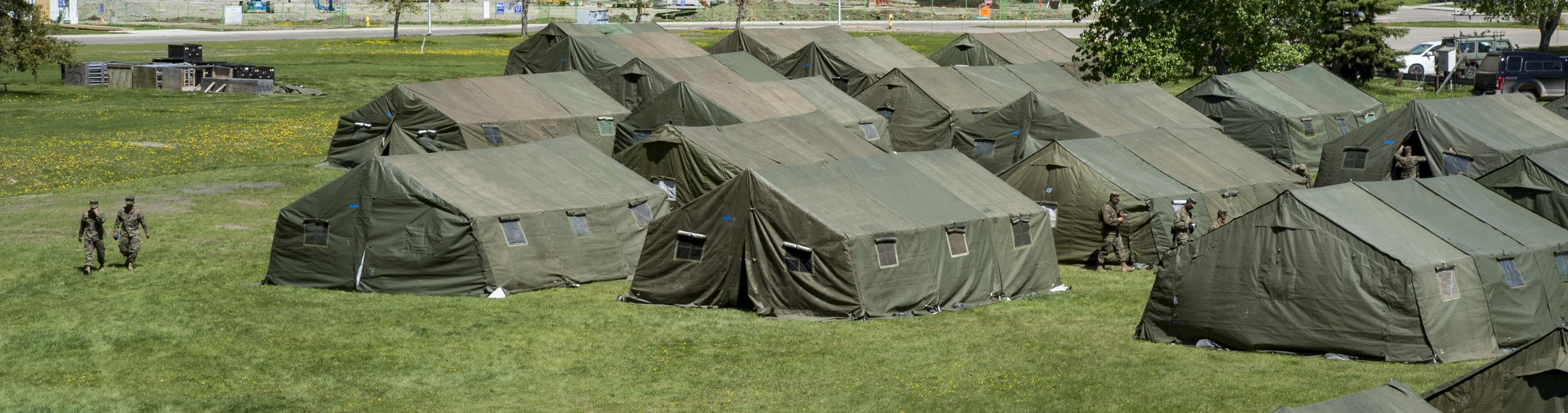 Personnel from the United States Marine Corps construct their living quarters on May 28, 2017. The tents are their temporary homes for the duration of Exercise Maple Flag 50 at 4 Wing Cold Lake, Alberta.  PHOTO: Master Corporal H.J.L. MacRae, CK05-2017-0461-001
