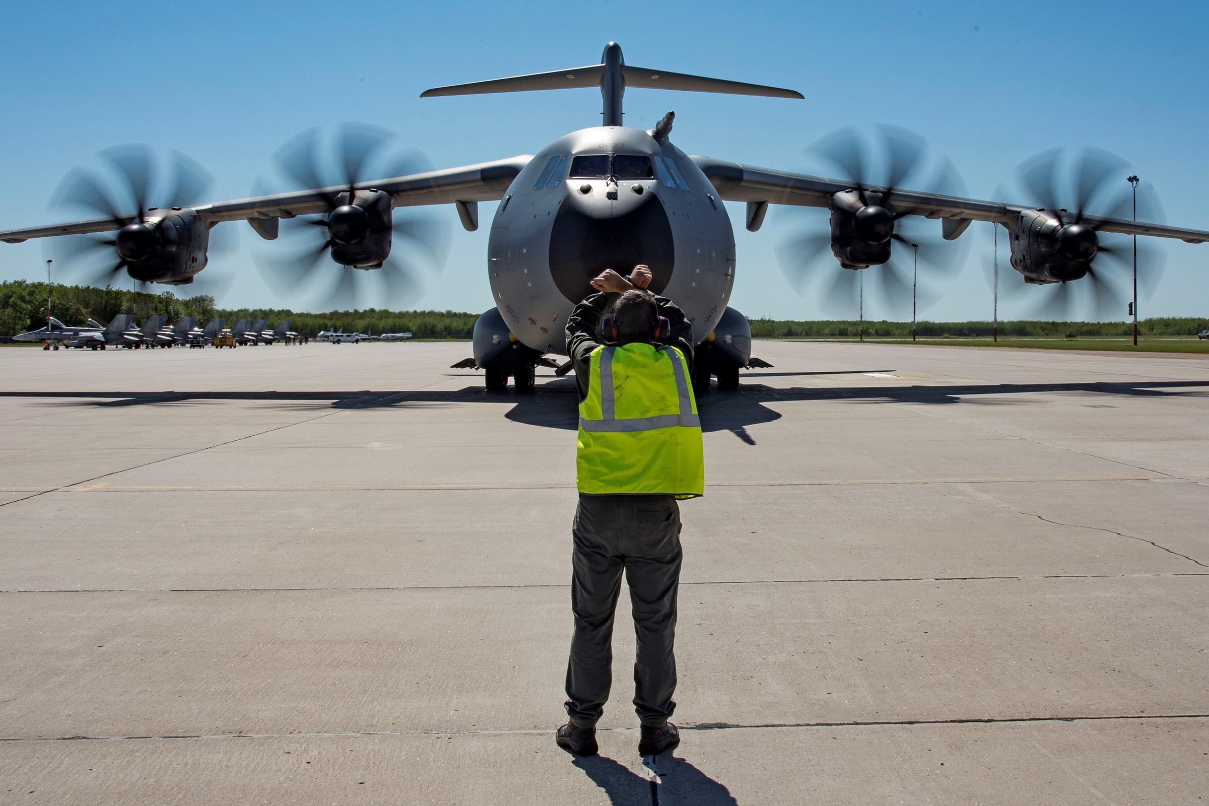 A French Air Force technician marshals a A400M Atlas aircraft after landing on the tarmac at 4 Wing Cold Lake, Alberta, during Exercise Maple Flag 50 on May 29, 2017. PHOTO: Corporal Justin Roy, CK07-2017-0460-005