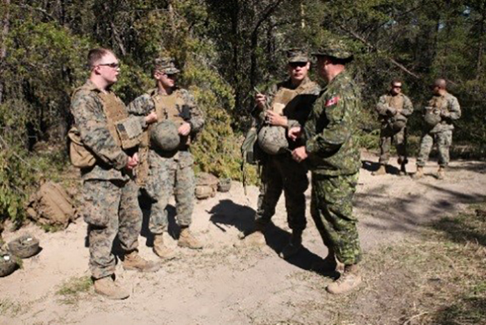 Warrant Officer Regenald McDonald (right front), a Royal Canadian Air Force construction engineer with 4 Construction Engineering Squadron, discusses obstacles with Marines from Engineer Company, 4th Marine Aircraft Wing, Marine Forces Reserve, during Exercise Maple Flag on May 28, 2017. PHOTO: 2nd Lieutenant Stephanie Leguizamon, US Marine Corps