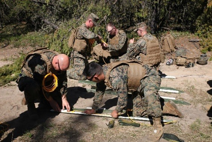 US marines with Engineer Company, Detachment Bravo, Marine Wing Support Squadron 473, 4th Marine Aircraft Wing, Marine Forces Reserve, measure detonating cord to create a field-expedient Bangalore torpedo during Exercise Maple Flag on May 28, 2017. PHOTO: 2nd Lieutenant Stephanie Leguizamon, US Marine Corps