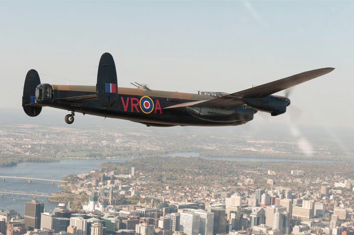 The Mynarski Lancaster, from the Canadian Warplane Heritage Museum, flies over Ottawa in 2014. PHOTO: Peter Handley