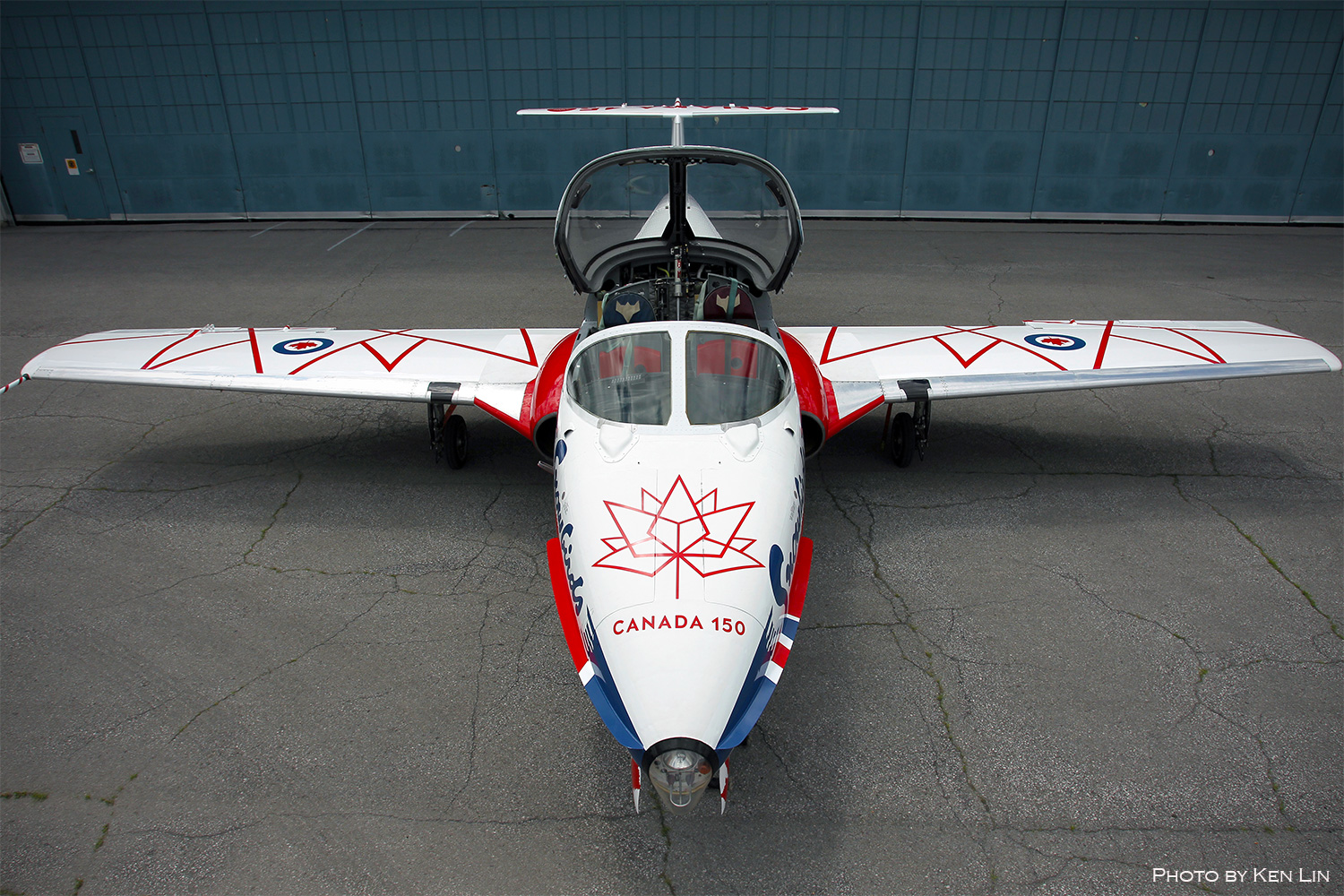 A red, white and blue aircraft