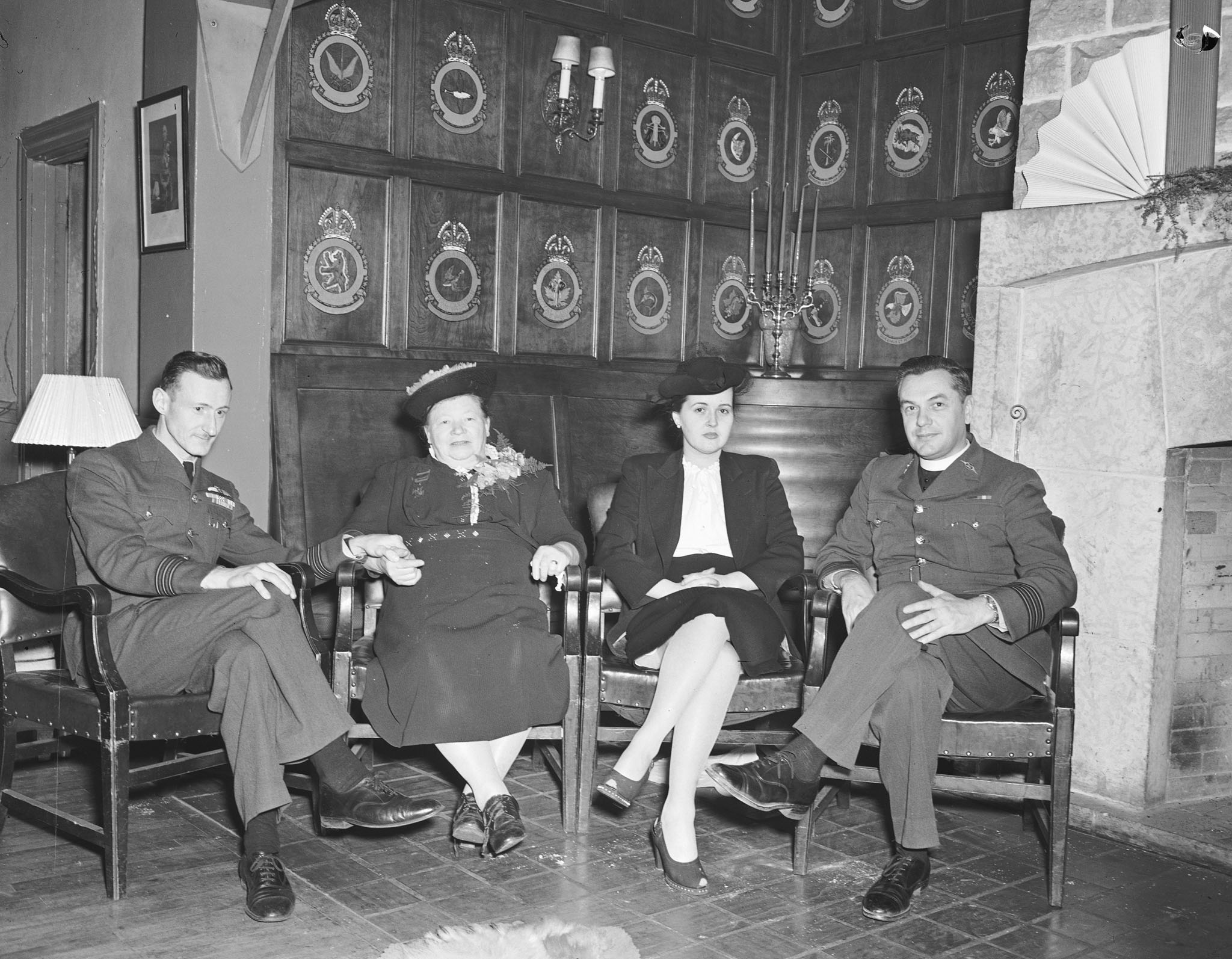 Mrs. Stanley Mynarski, mother of the late Pilot Officer Andrew Mynarski, was guest of honour for a tea at the RCAF Mess on December 13, 1945, while in Ottawa to receive her citizenship papers. From left to right: Wing Commander Len Birchall, Mrs. Mynarski, Mrs. Birchall and Wing Commander, L.A. Costello, senior RCAF Roman Catholic chaplain. PHOTO: DND Archives, PL-38317