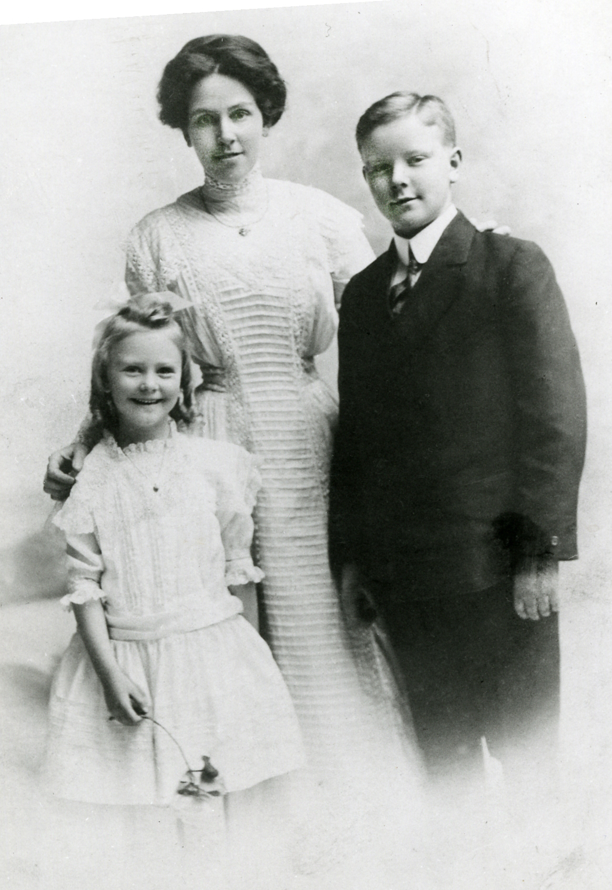 Alan McLeod stands with his mother and sister in an undated photograph. PHOTO: Submitted