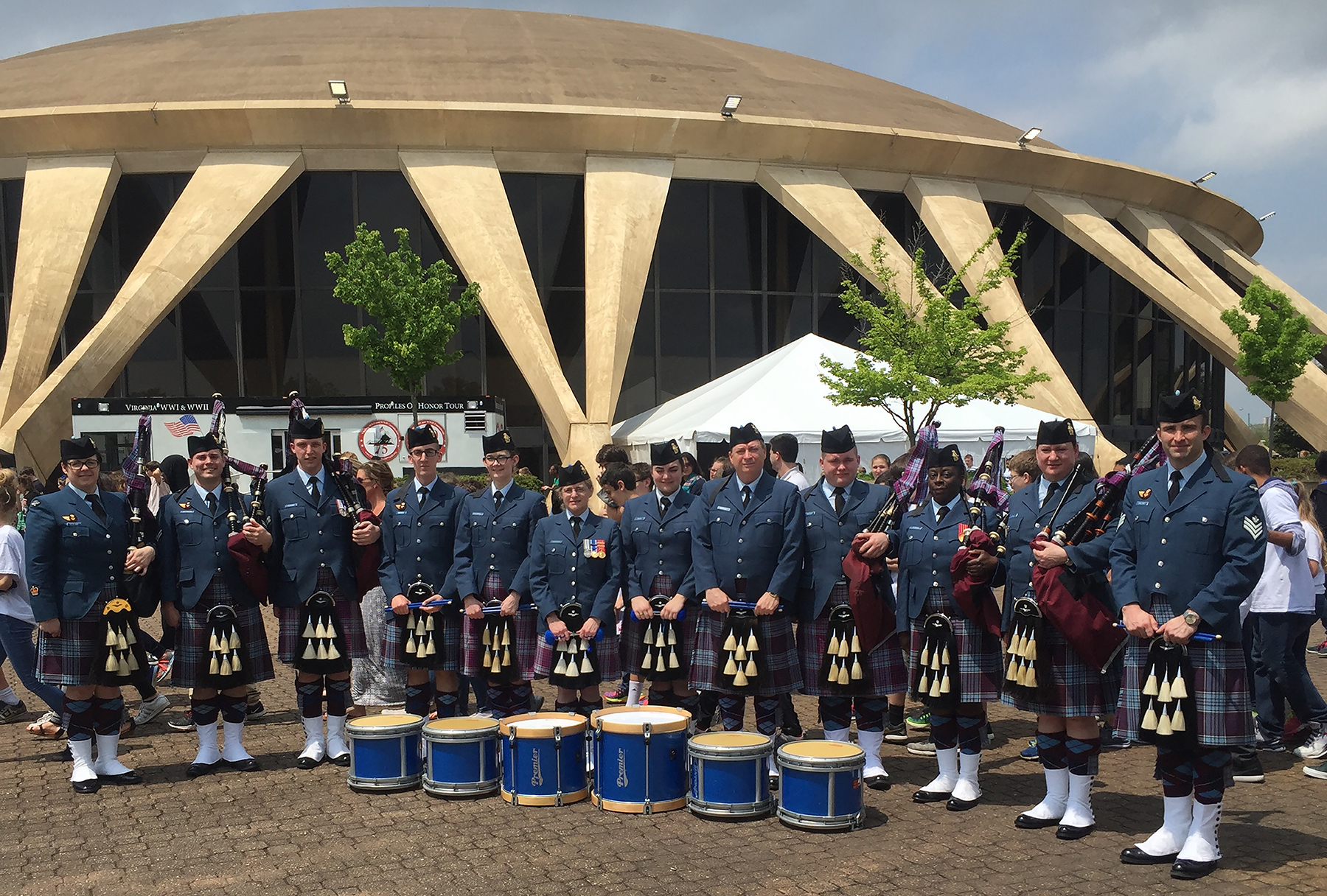 During the Virginia International Tattoo, the 12 Wing Pipes and Drums from Shearwater, Nova Scotia, gather for a photograph outside the Scope Centre in Norfolk, Virginia, after their matinee performance on April 28, 2016. PHOTO: Mark MacKisoc