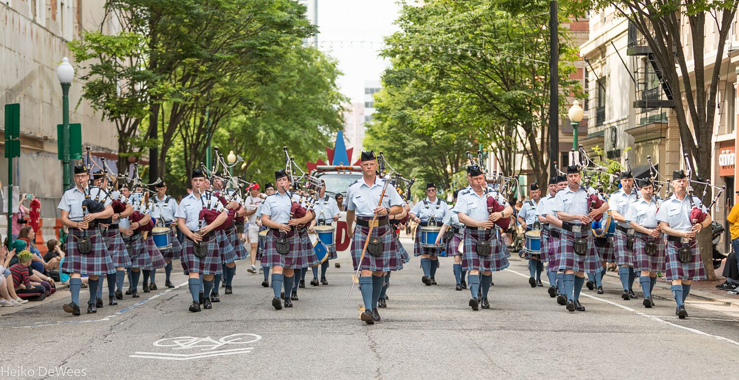 The combined RCAF Pipes and Drums marches through downtown Norfolk, Virginia, in the NATO-fest Parade. PHOTO: Heiko DeWees