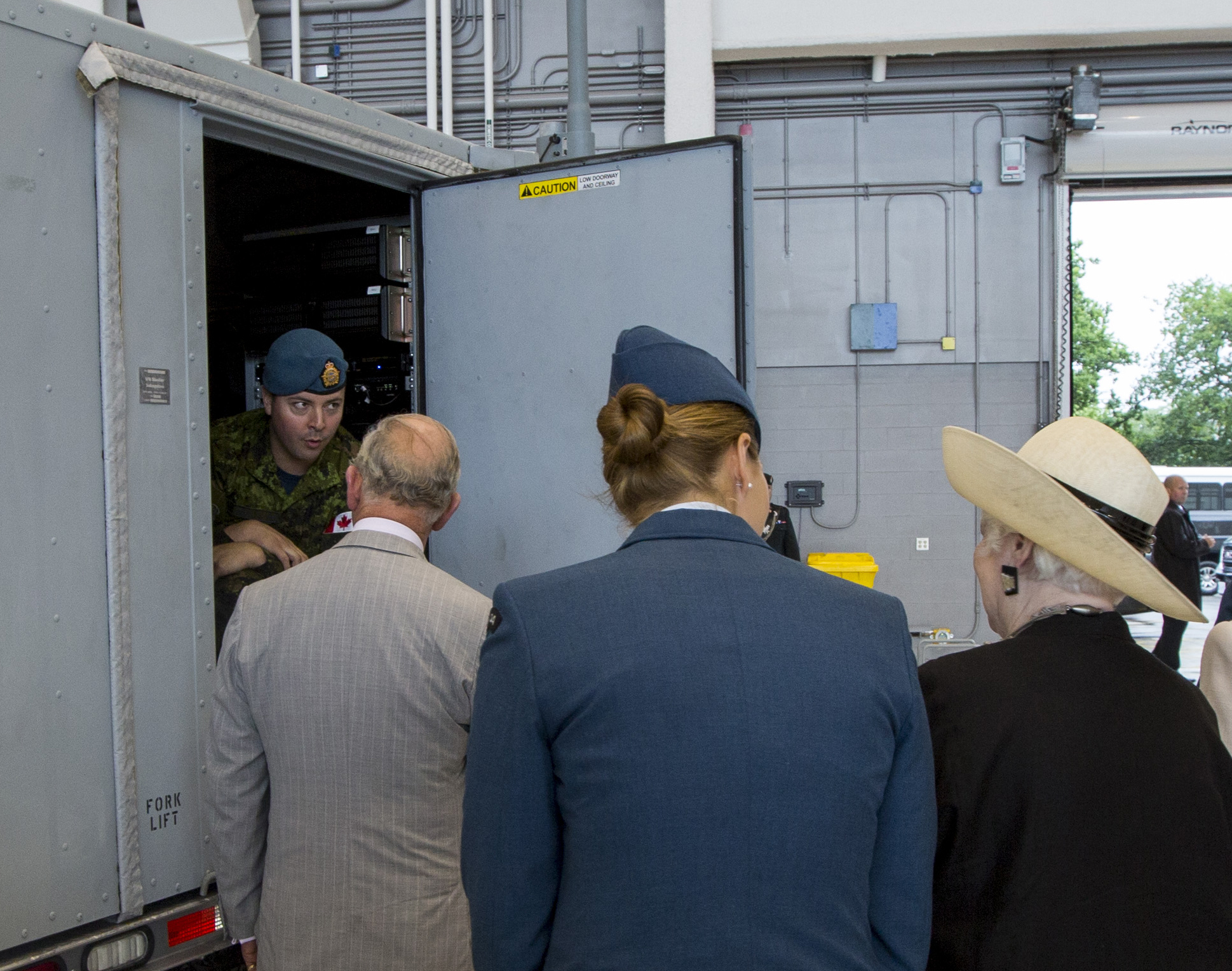 Prince Charles speaks with Sergeant Jean-Sebastien Lanoue (seated inside truck), an aerospace control operator-radar with 8 Air Communications and Control Squadron. PHOTO: Canadian Heritage