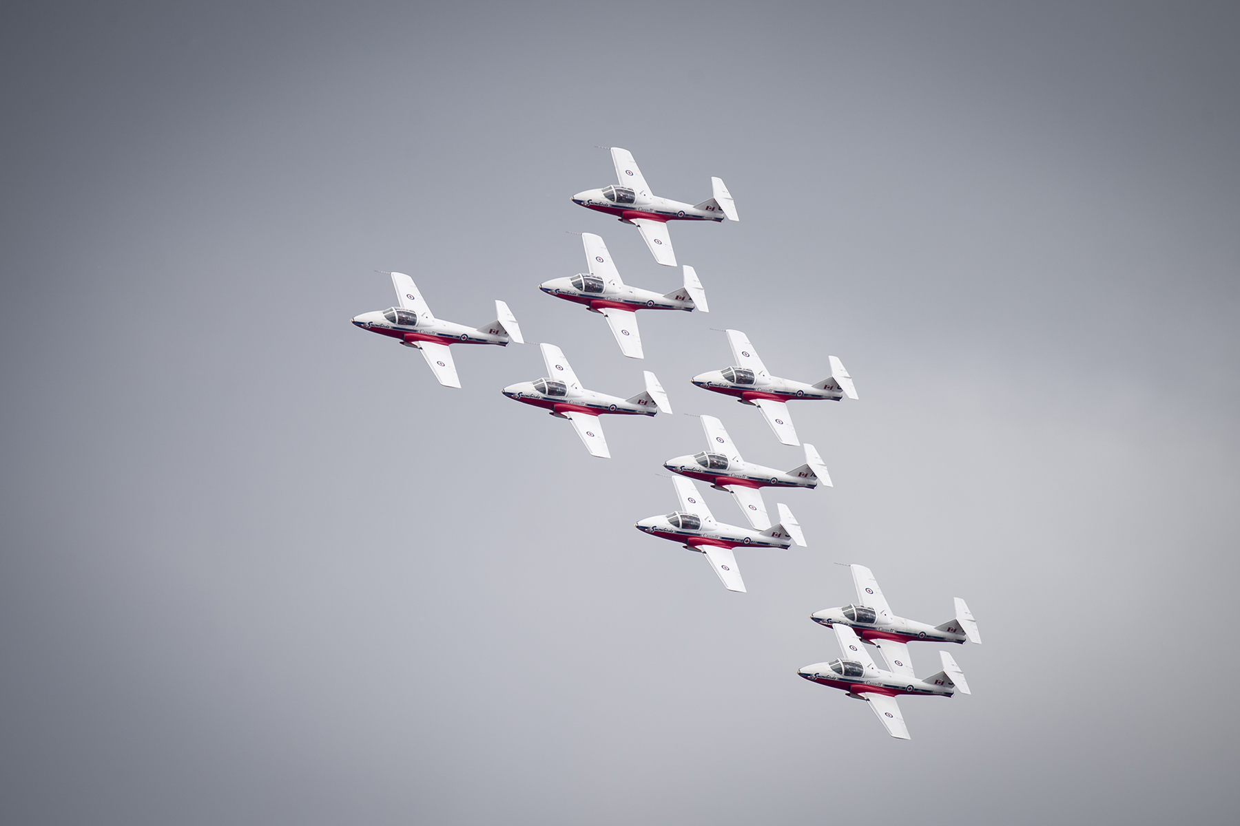 A grey backdrop of cloud lets the Snowbirds gleam in watery sunshine. The CT-114 Tutor aircraft performed over Parliament Hill in Ottawa, Ontario, on July 2, 2017, in celebration of the 150th anniversary Canada's confederation. PHOTO: Corporal Michael J. MacIsaac, SU12-2017-0794-217