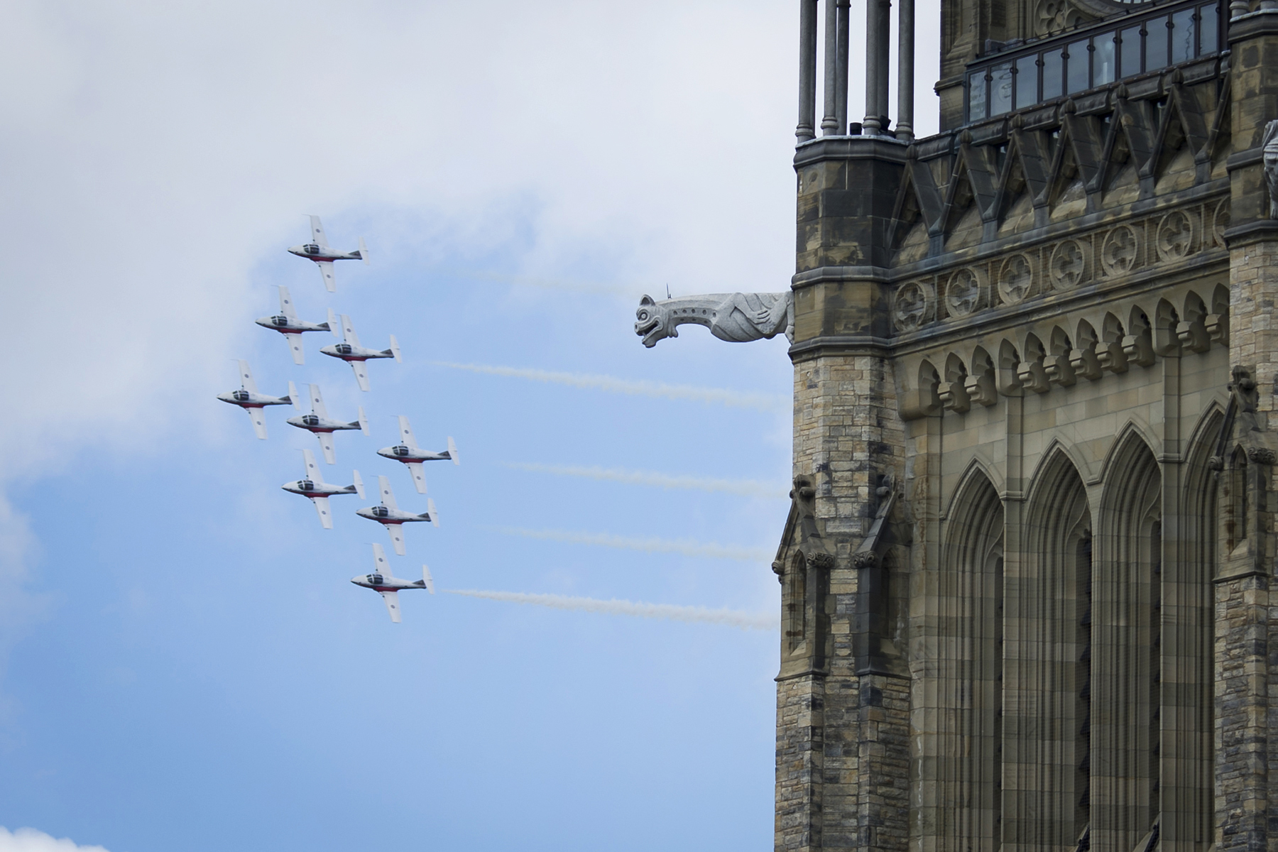 A Wedge formation of RCAF Snowbirds, a demonstration team of CT-114 Tutor aircraft, flies past the Peace Tower on Parliament Hill in Ottawa, Ontario, on July 2, 2017, in celebration of the 150th anniversary of Canada's confederation. PHOTO: Corporal Michael J. MacIsaac, SU12-2017-0794-243