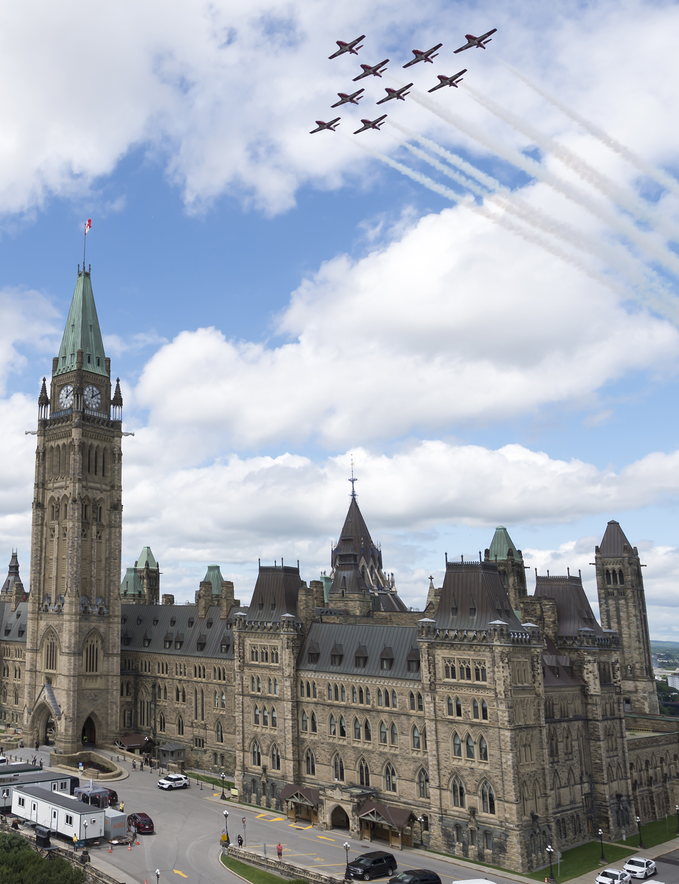 On July 2, 2017, the RCAF demonstration team of CT-114 Tutor aircraft, the Snowbirds, passes over the Peace Tower on Parliament Hill in Ottawa, Ontario, in a perfect Concord formation to mark the 150th anniversary of Canada's confederation. PHOTO: Corporal Michael J. MacIsaac, SU12-2017-0794-375