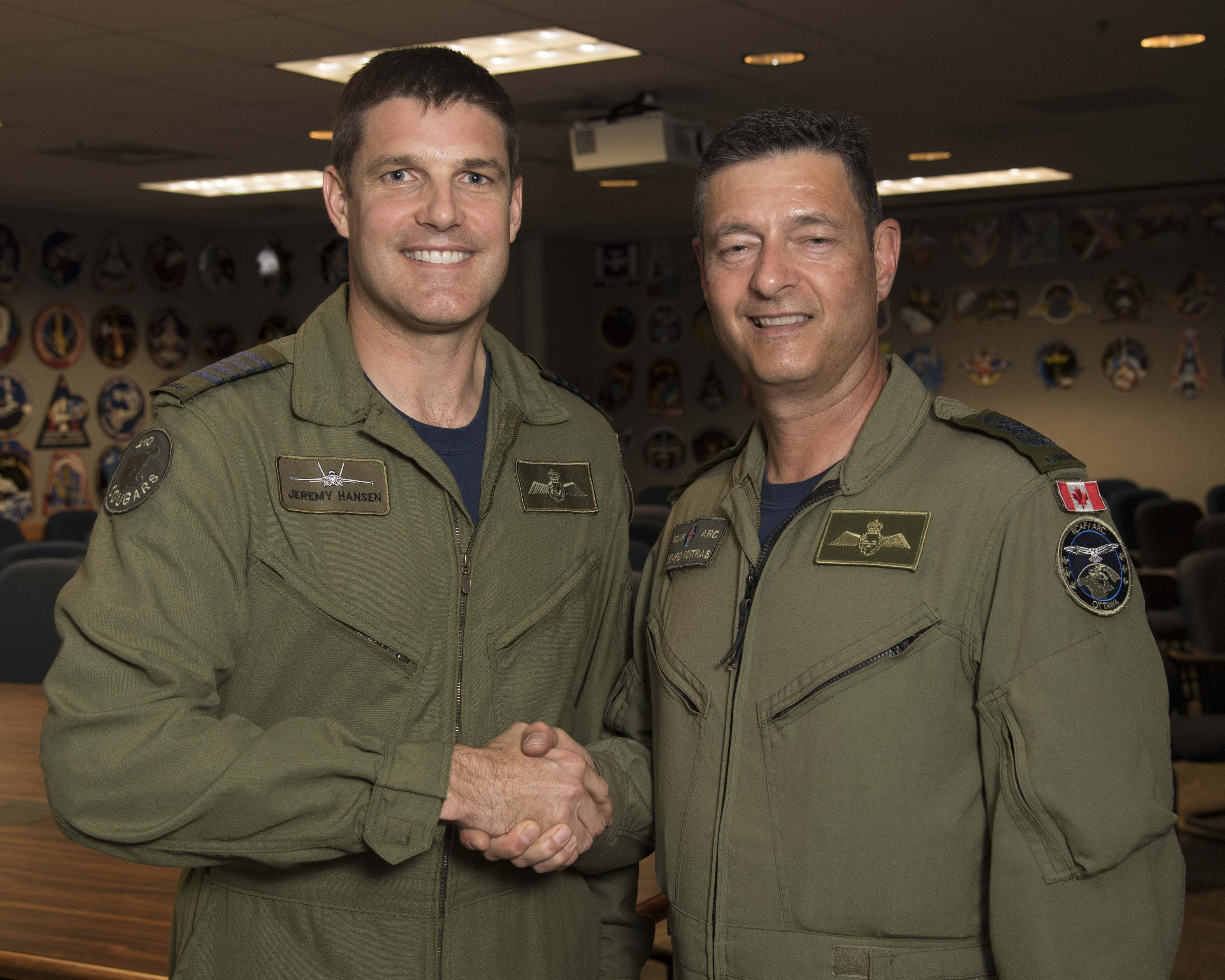 Chief Warrant Officer Gérard Poitras, chief warrant officer of the Royal Canadian Air Force, congratulates Colonel Jeremy Hansen. PHOTO: NASA