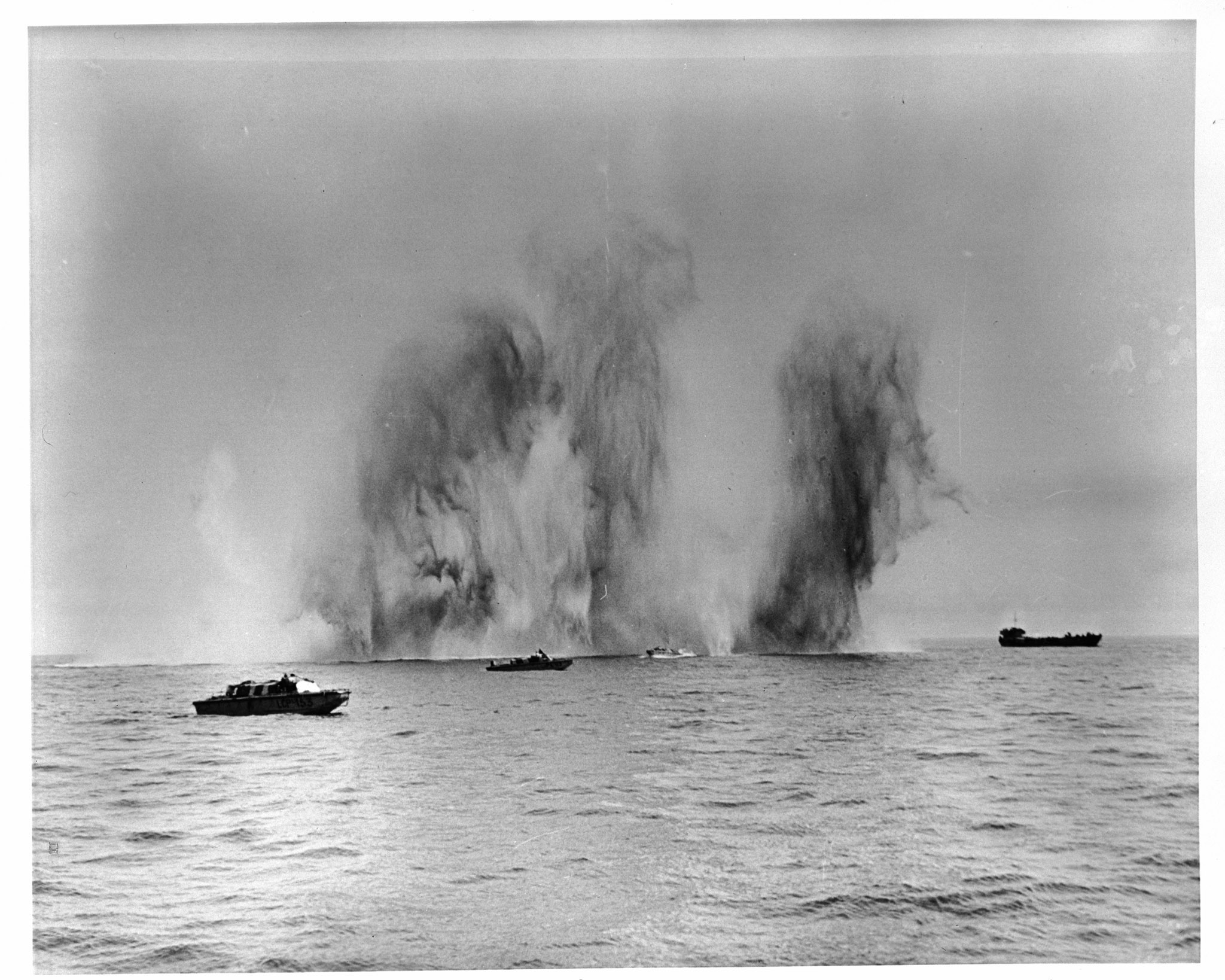 Canadians in landing craft off Dieppe underwent a terrific dive bombing barrage. This photograph, taken by an official Canadian military photographer who accompanied the raiding force, shows some near misses. PHOTO: DND Archives, Z-8471-6