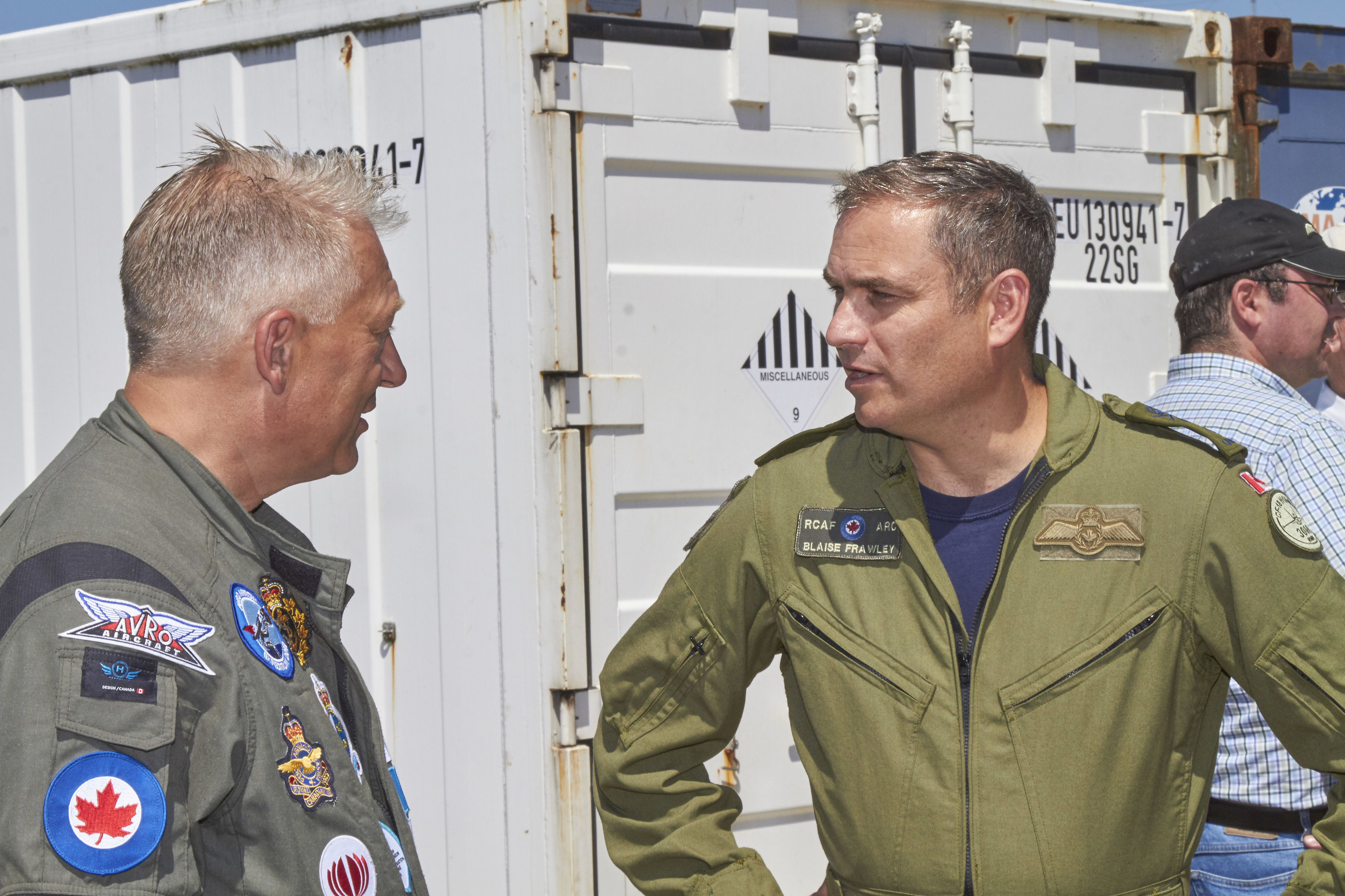 Major-General Blaise Frawley (right), deputy commander of the Royal Canadian Air Force, chats with John Burzynski, OEX Recovery Group Expedition Leader, about the work being done to find scale models of the Avro Arrow in Lake Ontario. PHOTO: Chris Nefs, 9 Yards Photography