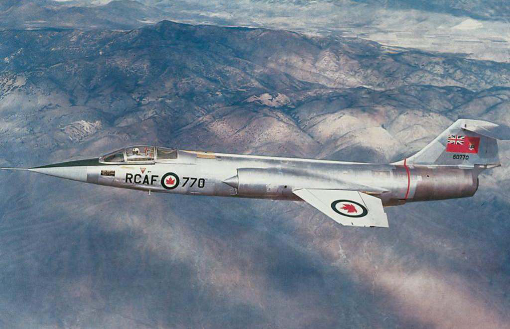 In an undated photograph, RCAF CF-104 No. 770 flies over foothills. PHOTO: DND