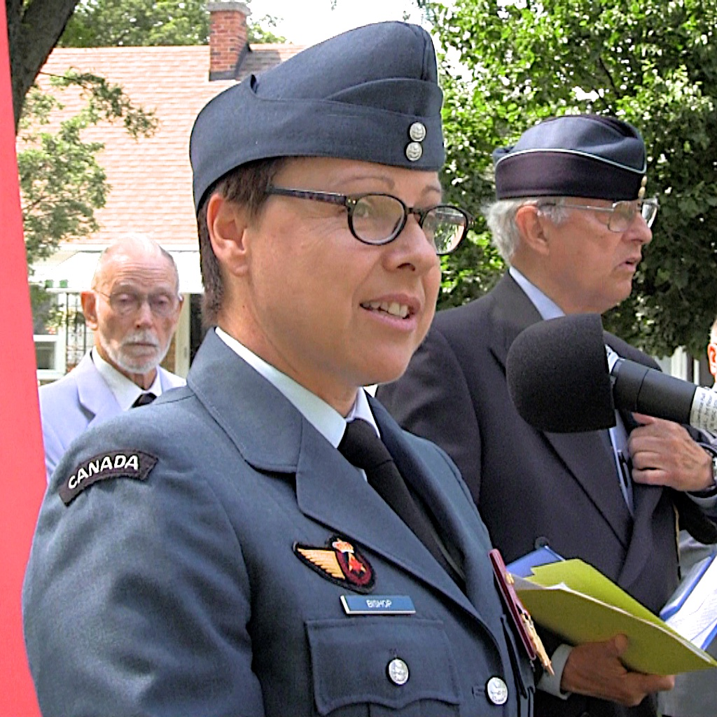 Lieutenant-Colonel Jillian Bishop, commanding officer of 400 Tactical Helicopter Squadron, speaks during the ceremony dedicating a plaque at the location of the Trethewey Airfield in Toronto. In the 1930s, Trethewey Airfield was home to RCAF's No. 10 Squadron, later the No. 110 (City of Toronto) Squadron, now the 400 Squadron. PHOTO: John Bertram, CAHS