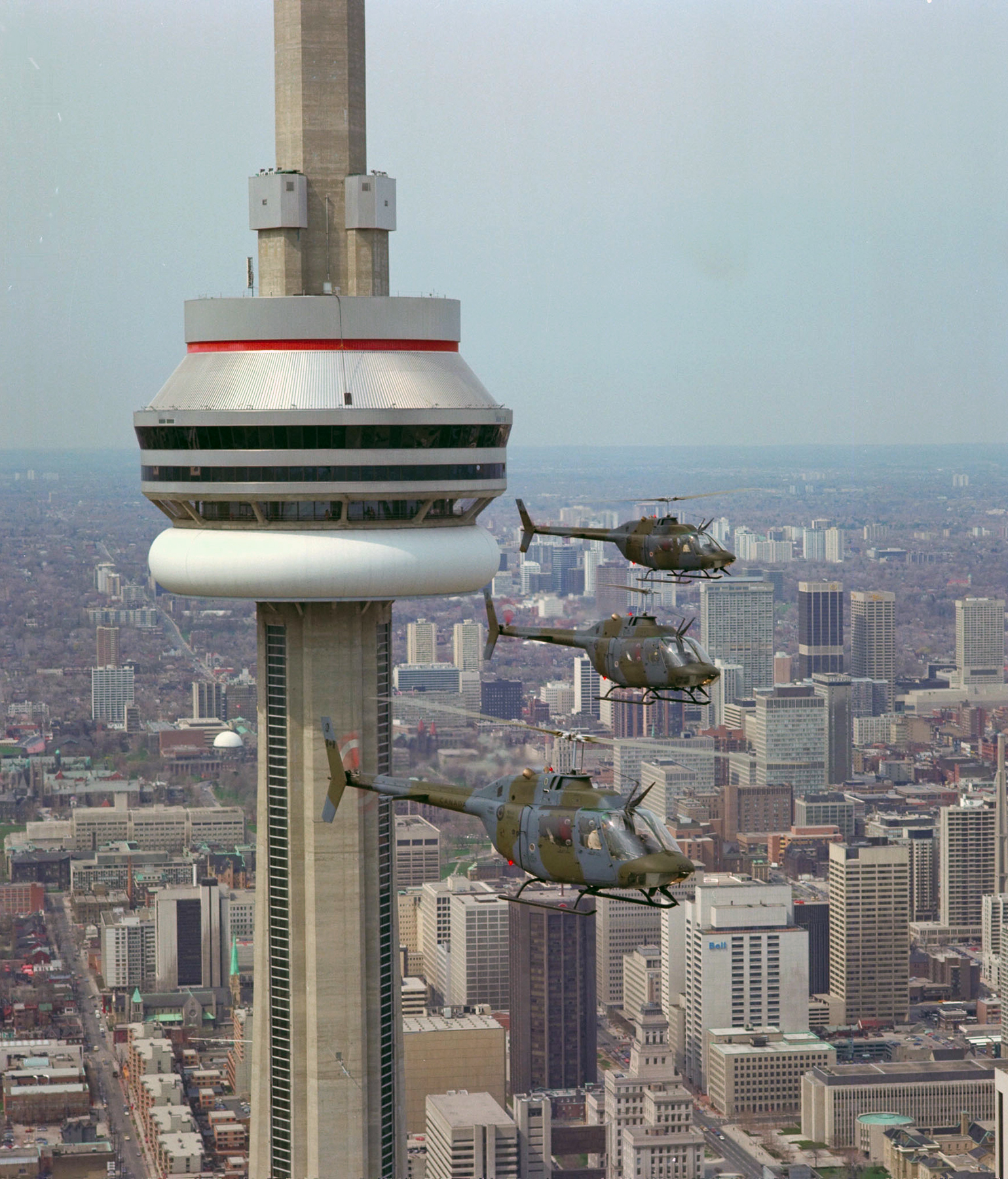 CH-136 Kiowa helicopters from 2 Air Reserve Wing at Canadian Forces Base Toronto fly past the CN Tower on April 28, 1983. PHOTO: Warrant Officer Vic Johnson, DND Archives, IOC83-165