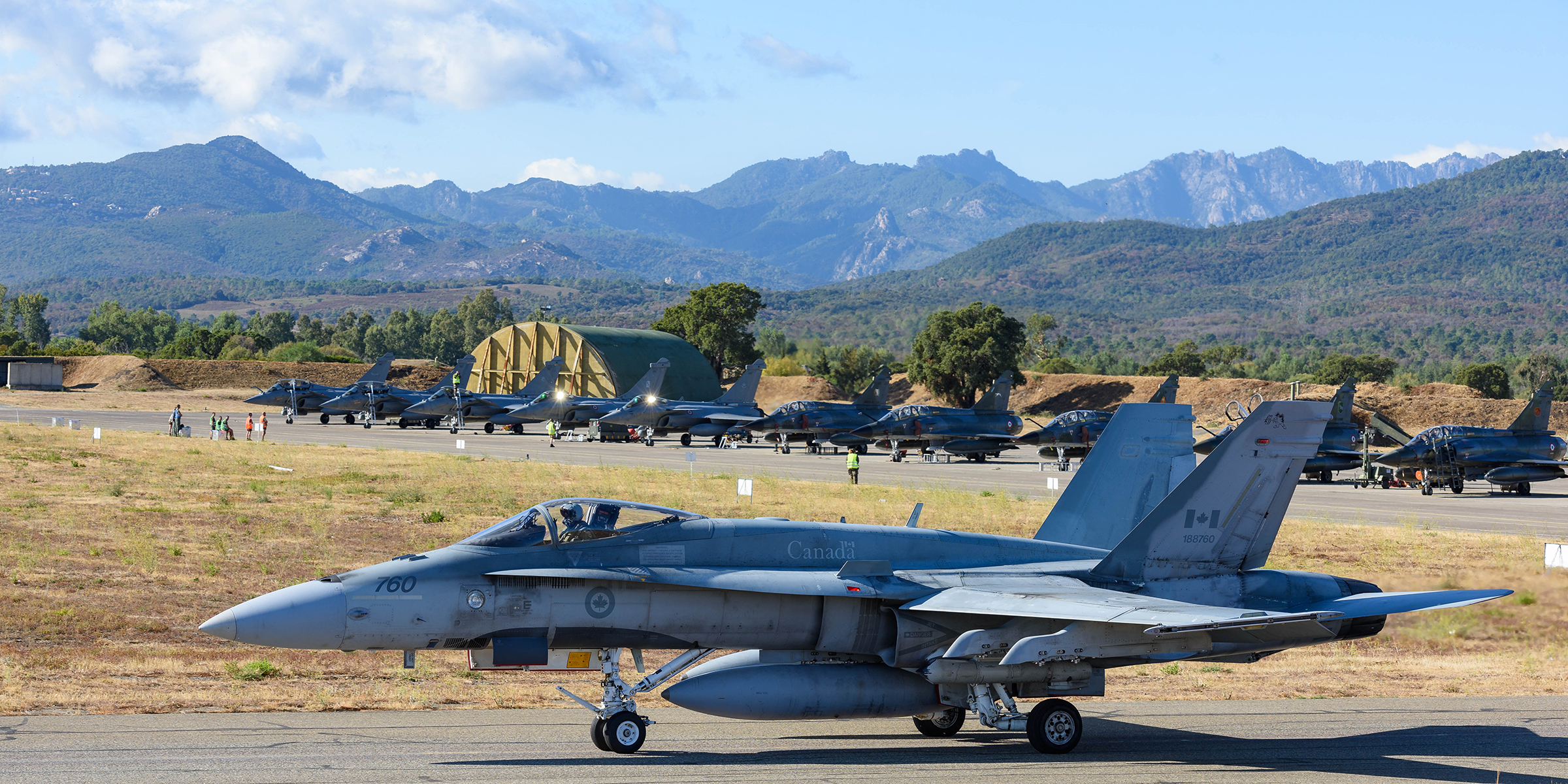 A Canadian CF-188 Hornet taxies to the runway on September 19, 2017 during SERPENTEX 2017 in Corsica. This image has been digitally modified for operational security. PHOTO: Master Corporal Louis Brunet, BN53-2017-0002-005