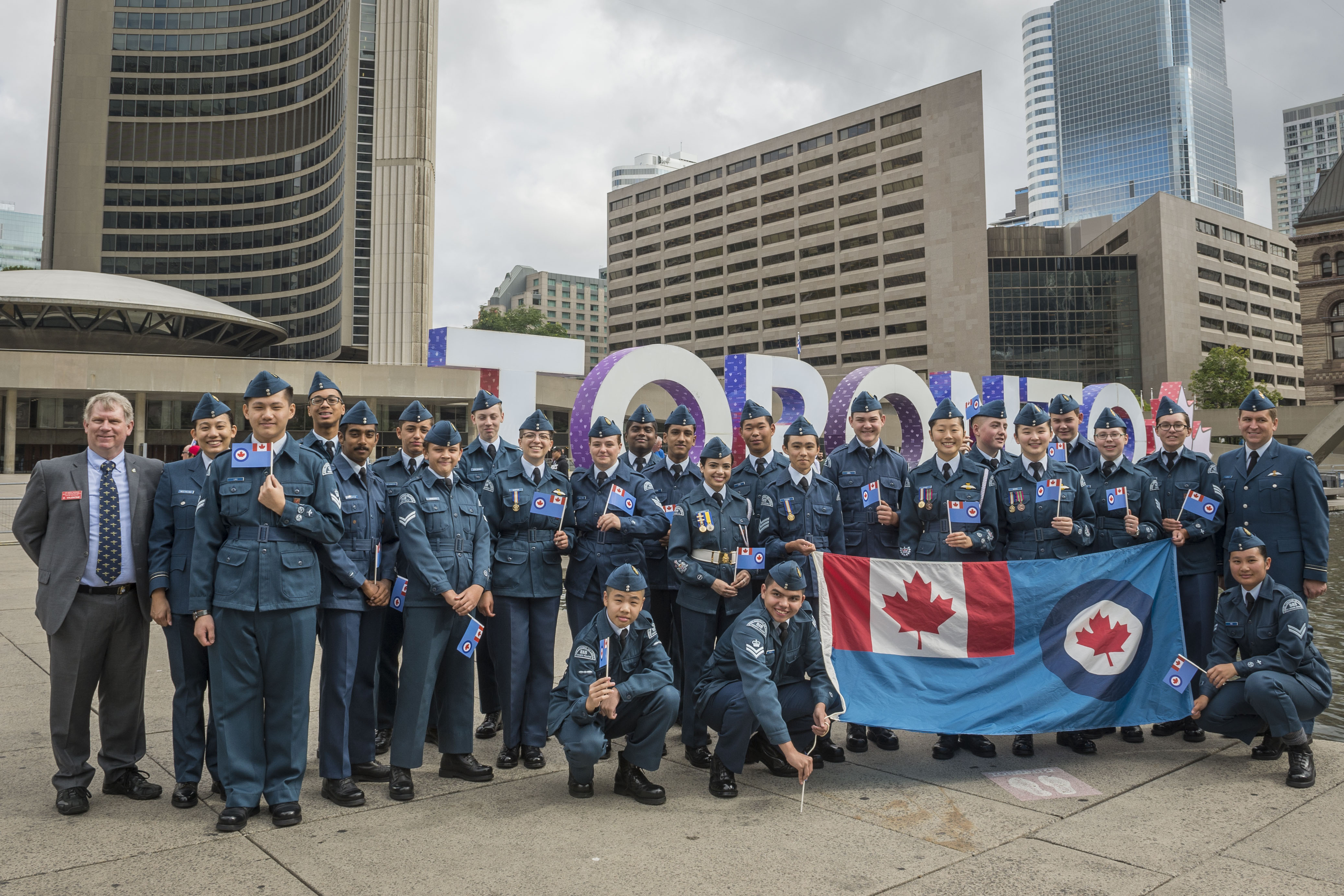 On August 31, 2017, Royal Canadian Air Force Cadets celebrate at the TORONTO sign at Nathan Phillips Square to mark the presentation of new Colours to the RCAF on September 1, also at Nathan Phillips Square. #RCAFProud PHOTO: Corporal Alana Morin, FA03-2017-0109-011