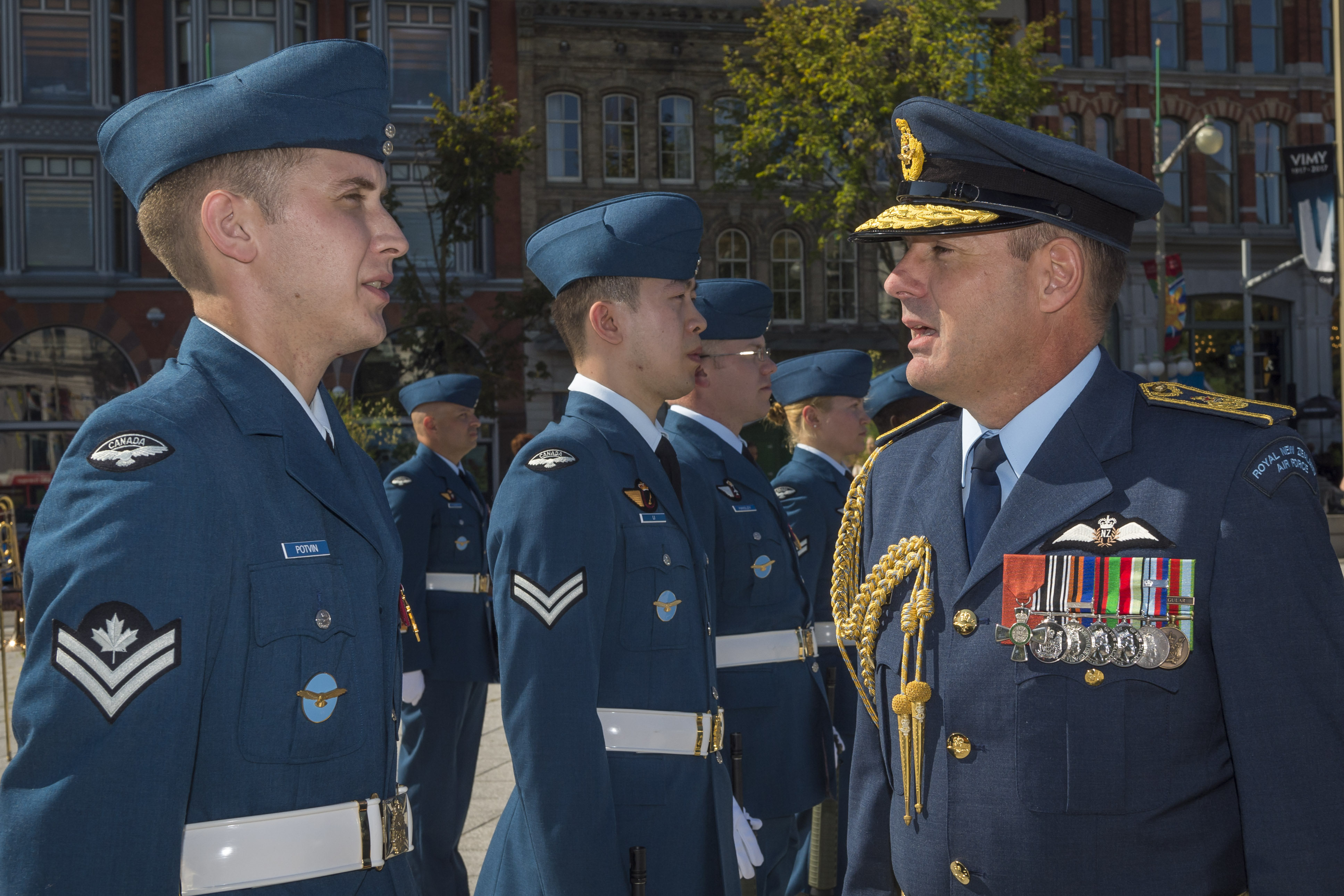 Several people wearing blue air force uniforms