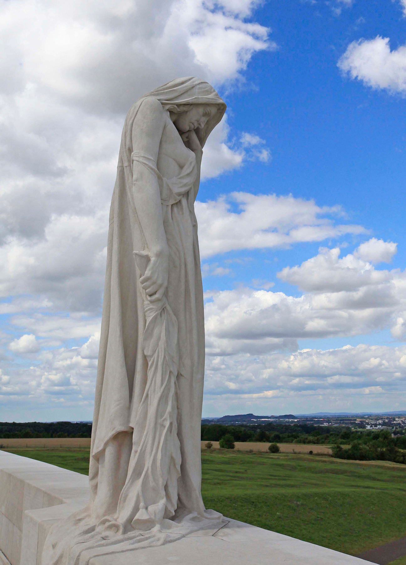 Designed by Canadian sculptor and architect Walter Seymour Allward, the Canadian National Vimy Memorial took 11 years to build. Twenty sculpted, symbolic figures grace the monument, each carved where they now stand from huge blocks of limestone. The largest, a mourning figure known as Canada Bereft, was carved from a single 30-tonne block. Head bowed in sorrow, she provides a powerful representation of Canada, a young nation grieving her dead. Carved on the walls of the monument are the names of 11,285 Canadian soldiers who were killed in France and whose final resting place was then unknown. PHOTO: Veterans Affairs Canada