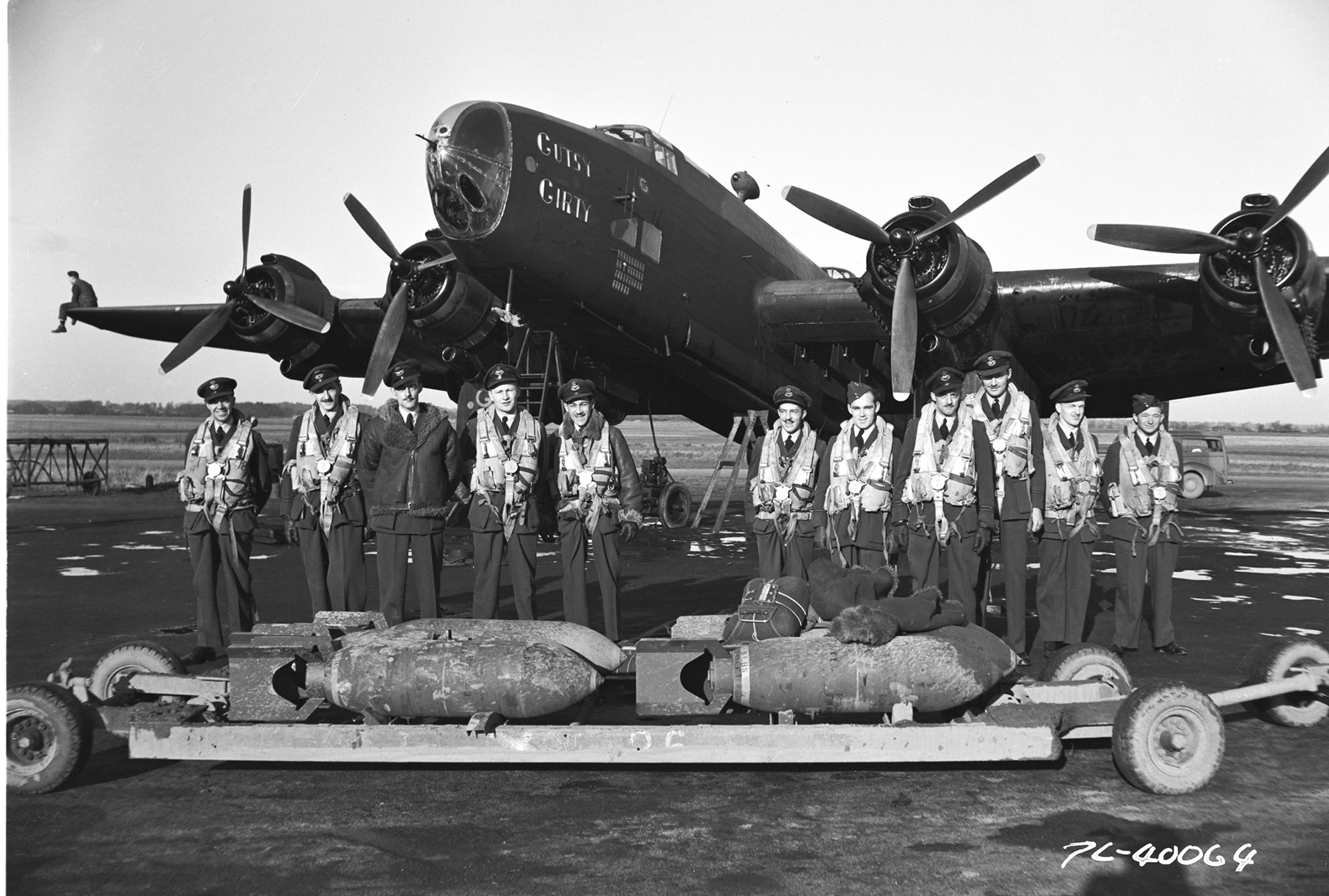 "Handley Page Halifax B MK III ""Gutsy Girty"" and her crew, of 427 Squadron, await arming at Leeming, Yorkshire, before a night operation during the Second World War. PHOTO: DND Archives, PL-40064"
