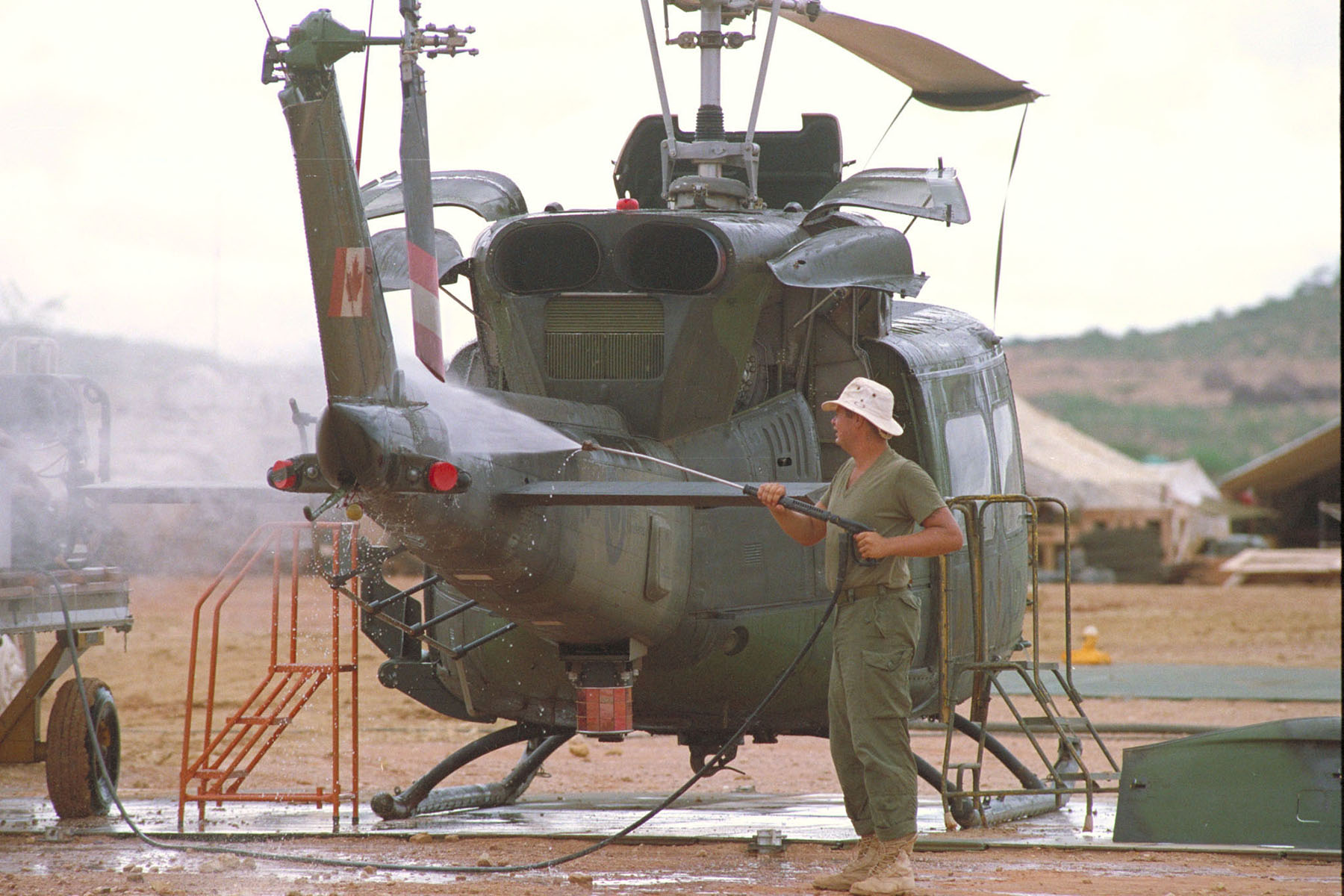 On May 9, 1993, Corporal Steve Popp of 427 Squadron washes a CH-135 Twin Huey helicopter. PHOTO: Sergeant Ed Dixon, ISC93-10482
