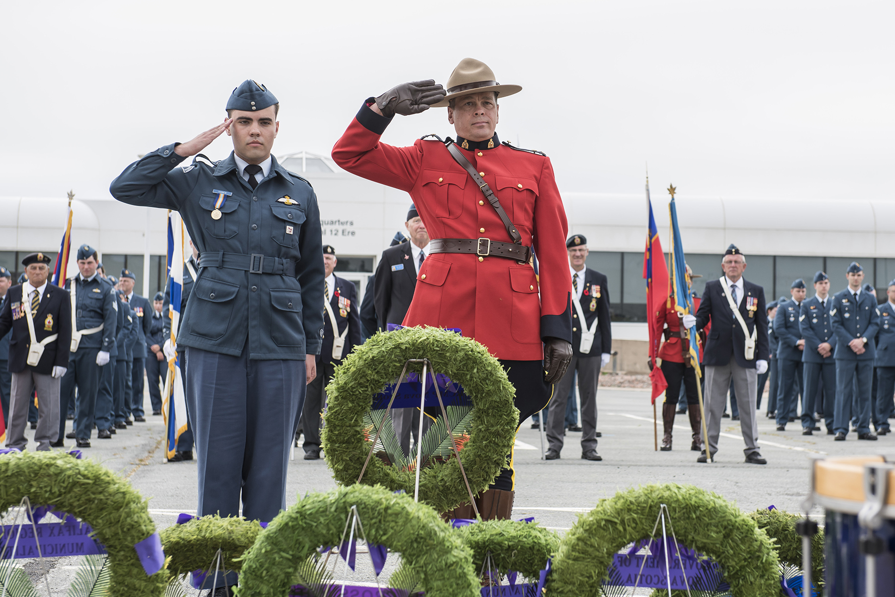 Inspector Jason Popik (right), Halifax District Royal Canadian Mounted Police Operations Officer, accompanied by Flight Sergeant Greg Hannem, from 250 Vimy Royal Canadian Air Cadet Squadron, salutes after laying a wreath during the Battle of Britain ceremony held at 12 Wing Shearwater, Nova Scotia, on September 17, 2017. PHOTO: Corporal Anthony Laviolette, SW04-2017-0250-035