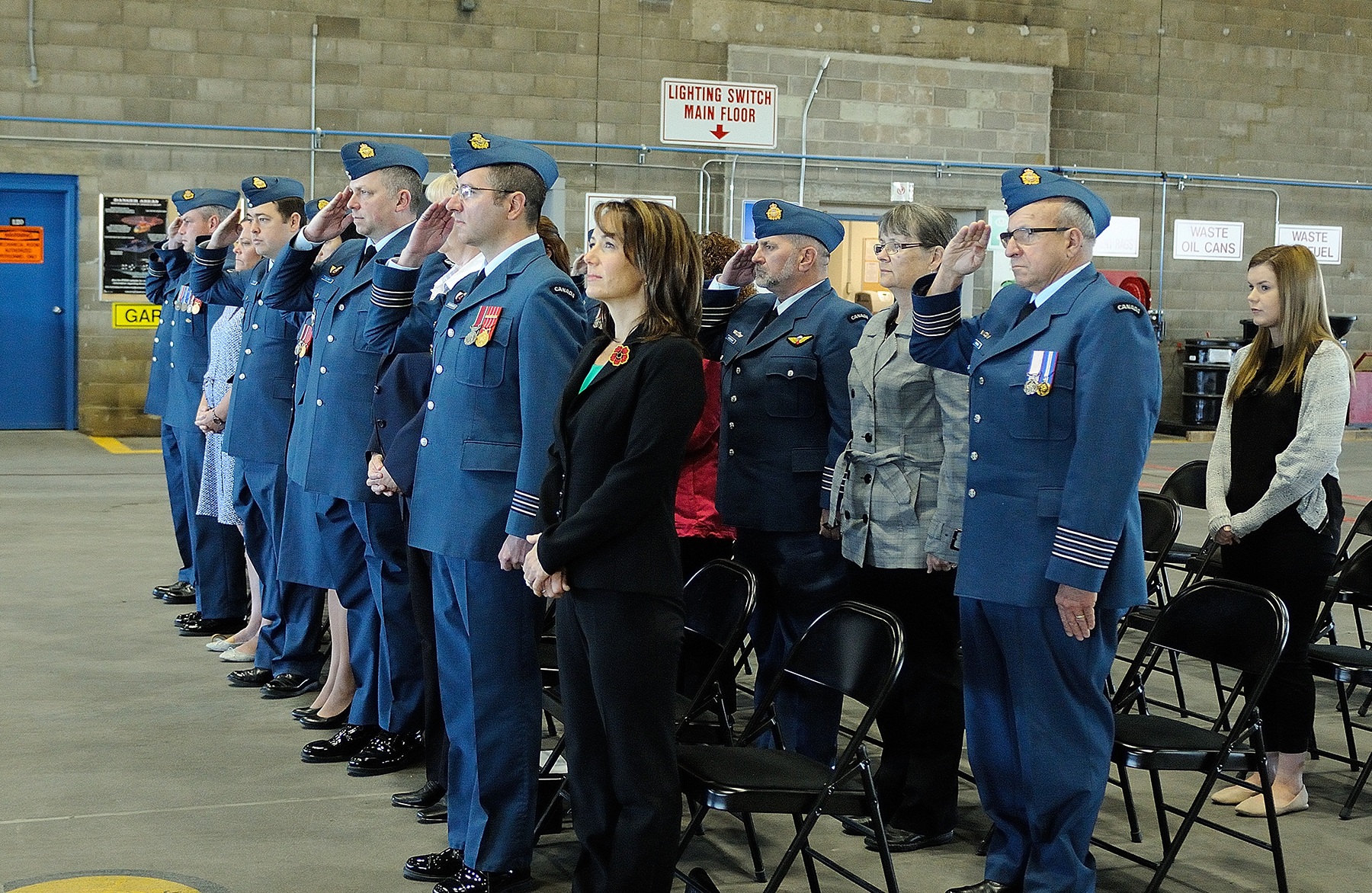 Standing with their families and friends, 5 Wing Goose Bay, Newfoundland and Labrador, personnel salute during the September 17, 2017, wing ceremony marking the 77th anniversary of the Battle of Britain. PHOTO: Master Corporal Krista Blizzard, GB2017-09-007