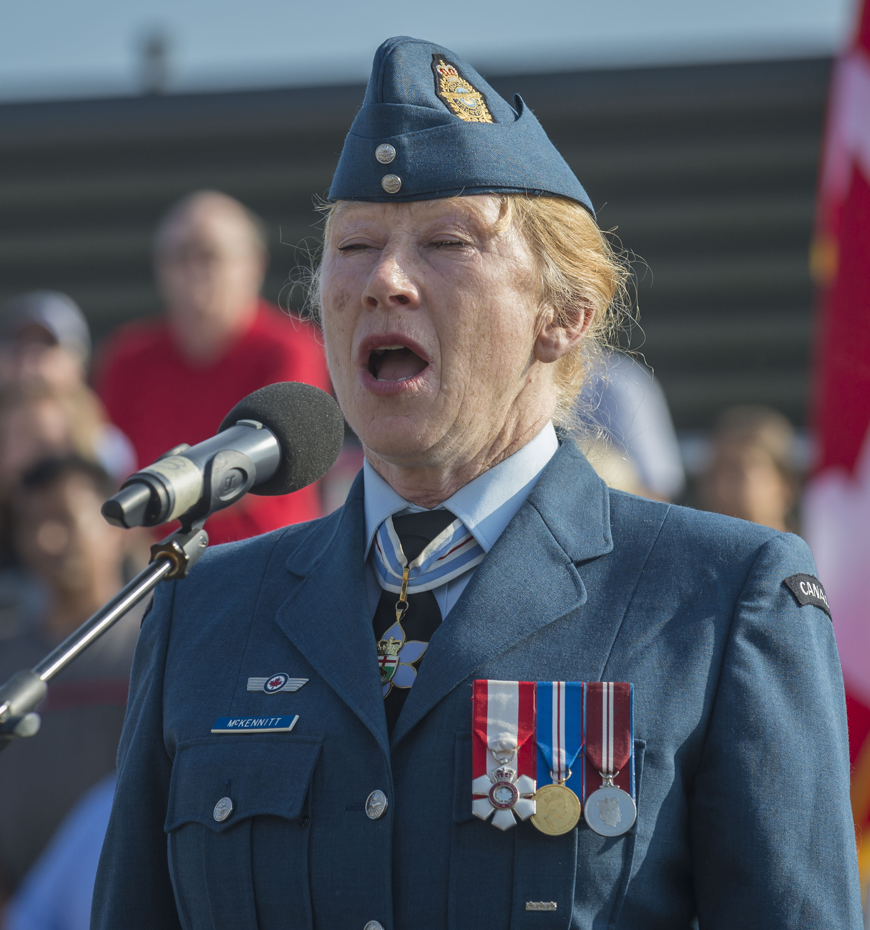"The RCAF's Honorary Colonel Loreena McKennitt sings ""O Canada"" during the national Battle of Britain commemorative ceremony in Gatineau, Quebec, on September 17, 2017. PHOTO: Corporal Alana Morin, FA03-2017-0119-005"
