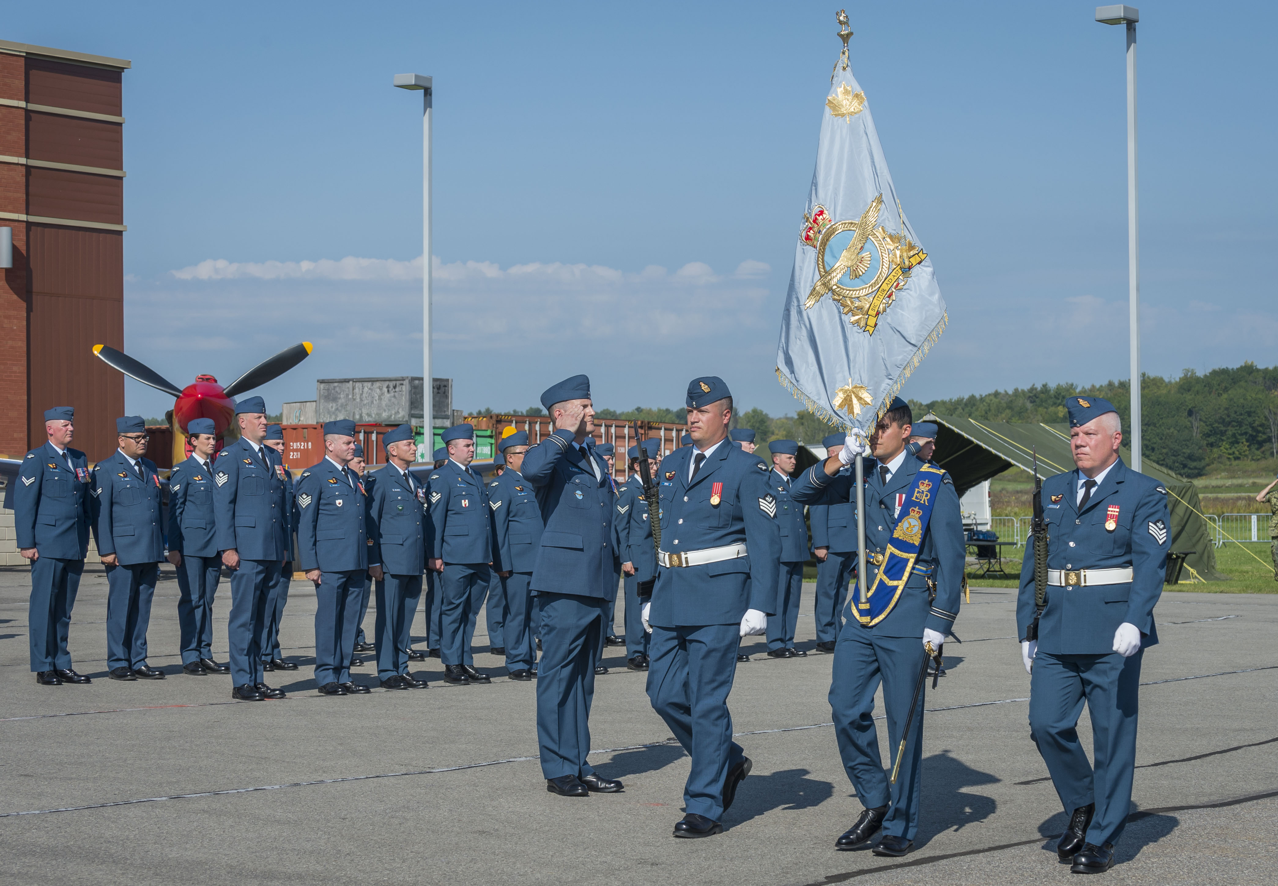 The RCAF's Command Colour is marched onto the parade square as the national Battle of Britain ceremony begins. The ceremony marked the first time the new Colour, which was presented just over two weeks previously, had been carried during an official ceremony. PHOTO: Corporal Alana Morin, FA03-2017-0119-033