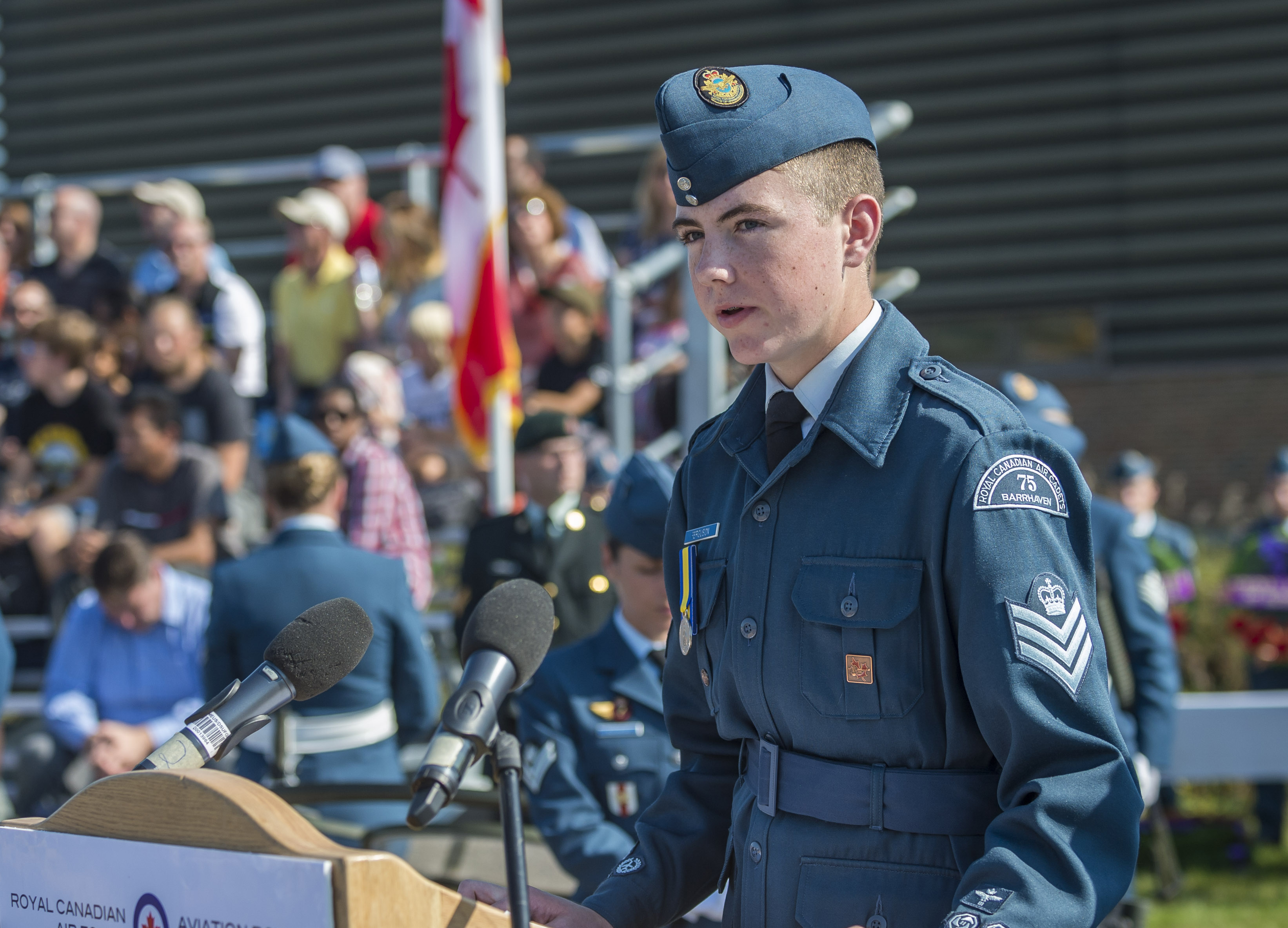 "Flight Sergeant Jacob Ferguson of 75 Barrhaven Royal Canadian Air Cadet Squadron reads the ""Commitment to Remember"" following the ""Act of Remembrance"" during the national Battle of Britain commemorative ceremony in Gatineau, Quebec, on September 17, 2017. PHOTO: Corporal Alana Morin, FA03-2017-0119-060"
