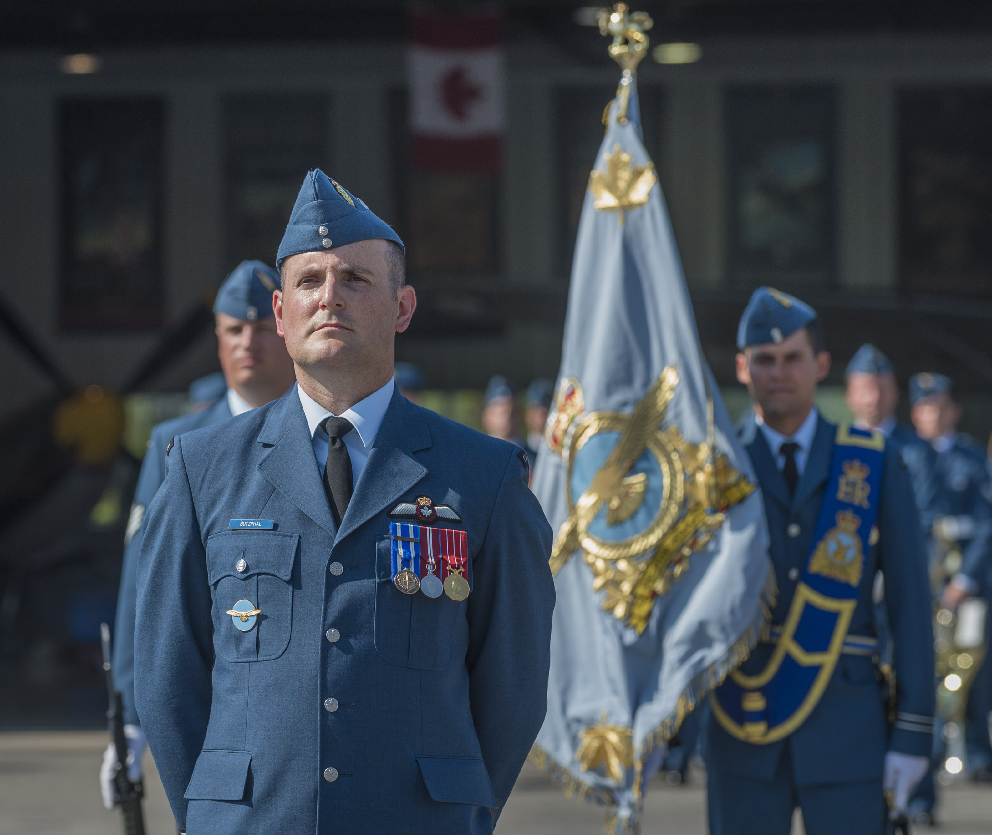 Parade commander Major Peter Butzphal of RCAF Headquarters in Ottawa stands at ease during the national Battle of Britain commemorative ceremony in Gatineau, Quebec, on September 17, 2017. The day began with heavy mist but became unseasonably hot as the day wore on – eventually reaching nearly 30C with a humidex. PHOTO: Corporal Alana Morin, FA03-2017-0119-103