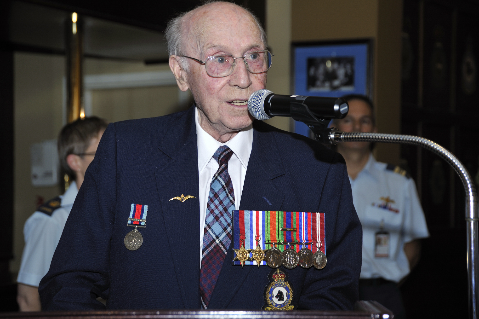 "In autumn 2012, Flight Lieutenant (retired) John Colton held military and civilian members of RCAF Headquarters Staff in Ottawa spell-bound as he spoke about his war-era experiences. The then-commander of the RCAF also presented him with a unique certificate of recognition that read, in part, ""For outstanding service to Canada in the Royal Canadian Air Force as a Typhoon fighter-bomber pilot in Europe during the Second World War. Through your bravery, courage, skill and audacity, you survived 104 combat missions and served as an inspiration to your fellow aviators during combat. Today, you are the ultimate role model for contemporary airmen and airwomen in the modern Royal Canadian Air Force."" PHOTO: Sergeant Pascal Quillé, FA2012-4000-21"