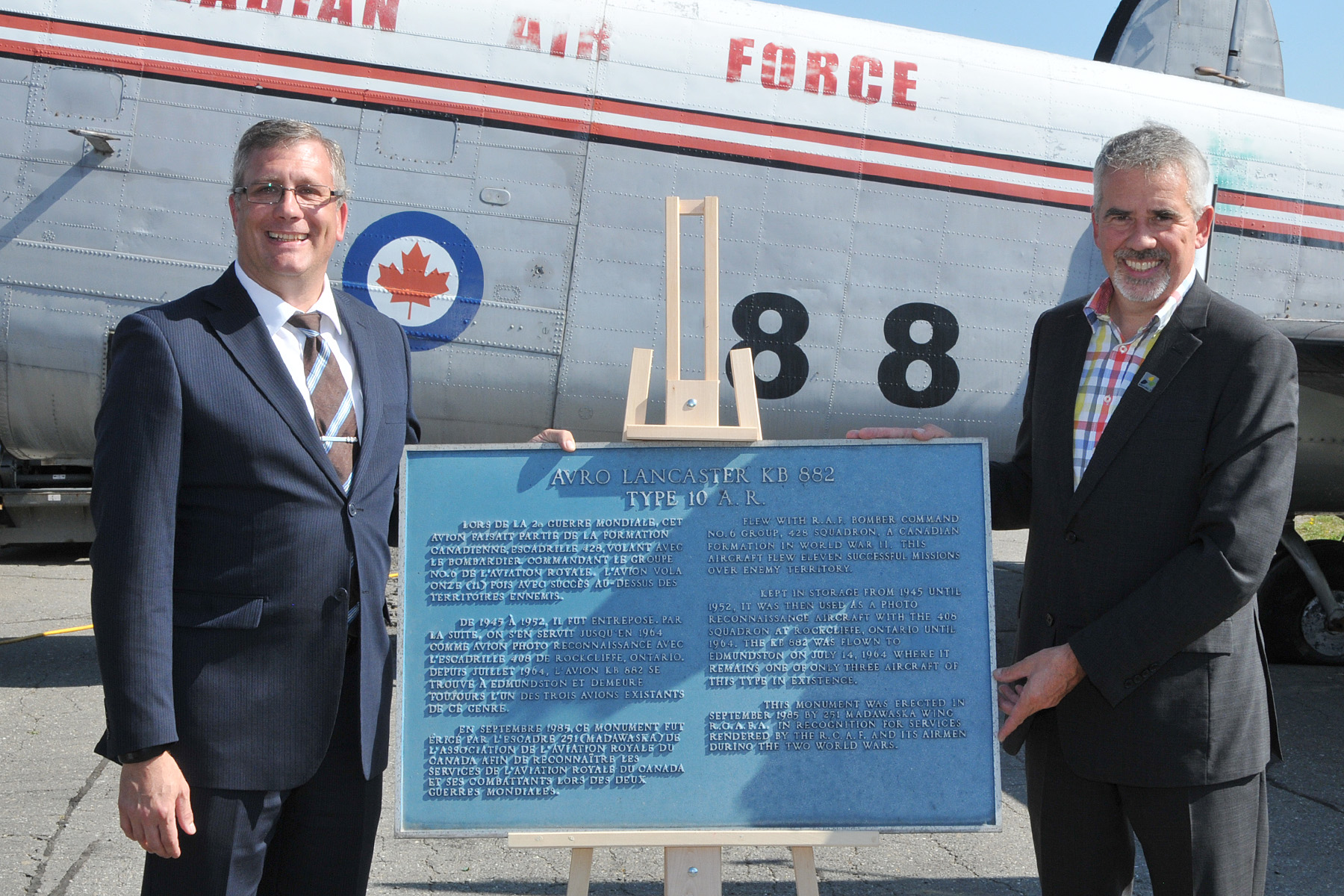 Mayor Cyrille Simard (right) presents Kevin Windsor, curator of the National Air Force Museum of Canada, with the historic plaque that was affixed to a plinth in front of KB882. PHOTO: Warrant Officer Fran Gaudet