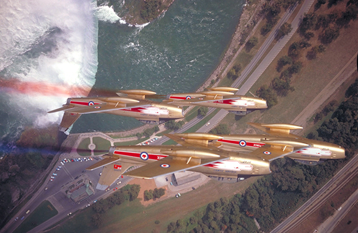 slide - Four gold coloured aircraft in flight.