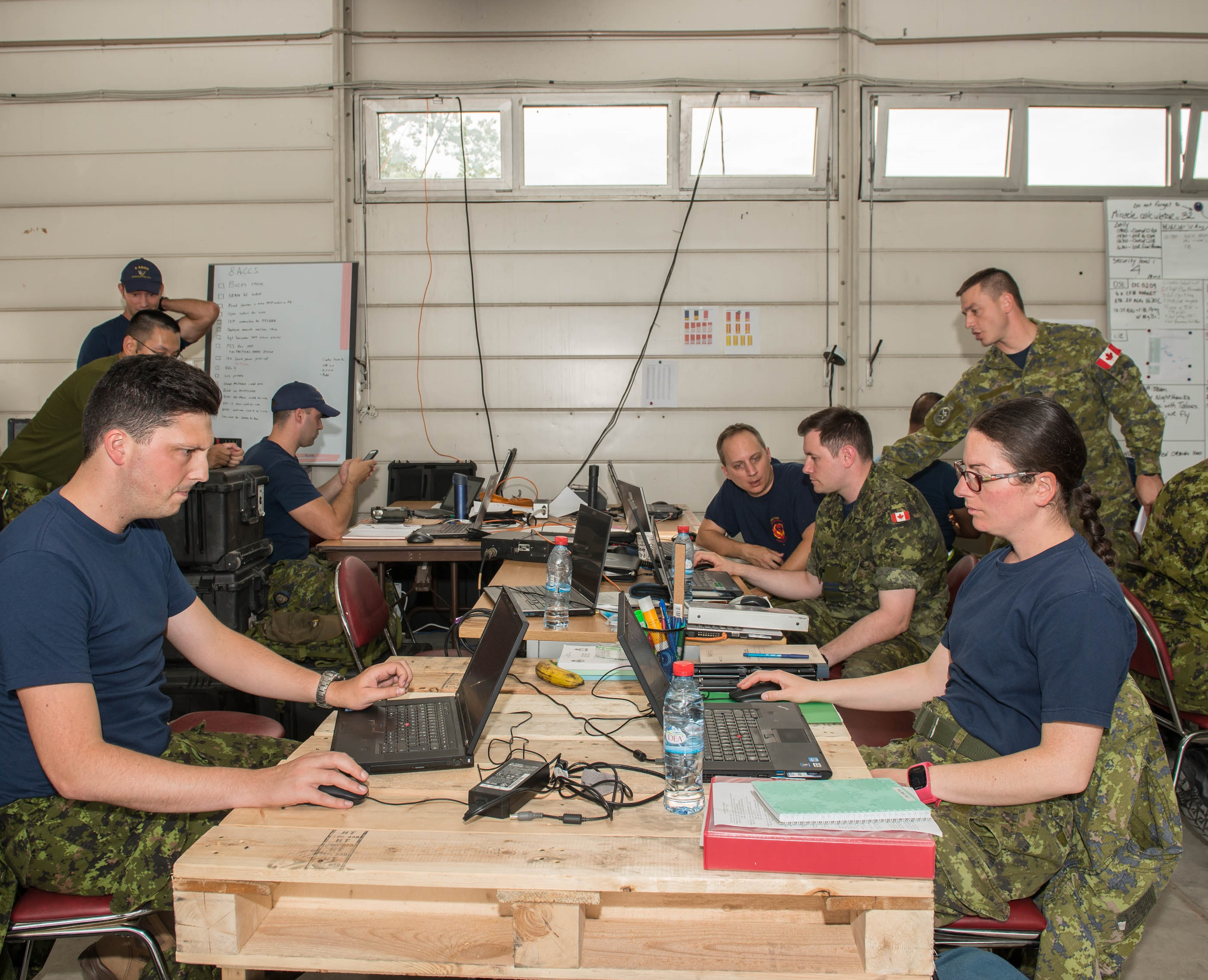 RCAF personnel from 8 8 Air Communication and Control Squadron (8 ACCS) work on setting up a temporary wing operations centre for Air Task Force-Romania at Mihail Kogalniceanu Air Base, Constanta, Romania. 8 ACCS is located at Trenton, Ontario, but is part of 2 Air Expeditionary Wing, which has its headquarters at Bagotville, Quebec. PHOTO: Sergeant Daren Kraus, RP14-2017-0004-03