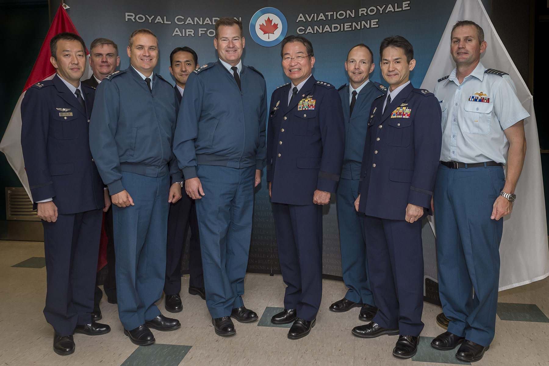 From left, Colonel Dan Suzuki, Air Attaché to the Embassy of Japan in the U.S.; Captain(N) Chris Dickinson, Canadian Defence Attaché to Japan; Major-General Blaise Frawley, Deputy Commander of the RCAF; Lieutenant Colonel Takehiro Lio, Staff, Defence Plans/Policies and Programs Division, Air Staff Office, Japan Air Self-Defense Force (JASDF); Lieutenant-General Michael Hood, Commander of the RCAF; General Yoshiyuki Sugiyama, Chief of Staff, Koku-Jieitai (JASDF); Major-General Alain Pelletier, Chief Fighter Capability, RCAF; Colonel Yasuhiro Ogawa, Deputy Director, Defence Plans/Policies and Programs Division, Air Staff Office (JASDF); and Colonel Christopher McKenna, Director of Air Plans, RCAF, stand for a photograph on the occasion of General Sugiyama's visit to National Defence Headquarters in Ottawa, Ontario. PHOTO: Corporal Alana Morin, FA03-2017-122-014
