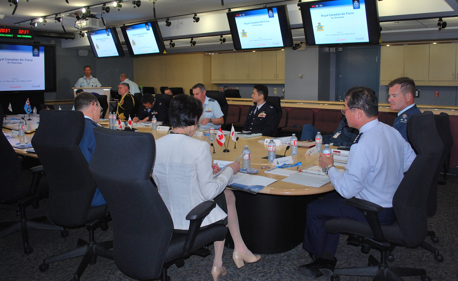 Lieutenant-General Michael Hood (right), Commander Royal Canadian Air Force; General Yoshiyuki Sugiyama (second right), Chief of Staff, Japan Air Self-Defense Force; and representatives of the Canadian Armed Forces and the Japan Air Self-Defense Force participate in an information session and discussion on September 22, 2017, at Canadian Joint Operations Command Headquarters in Ottawa, Ontario. PHOTO: Submitted