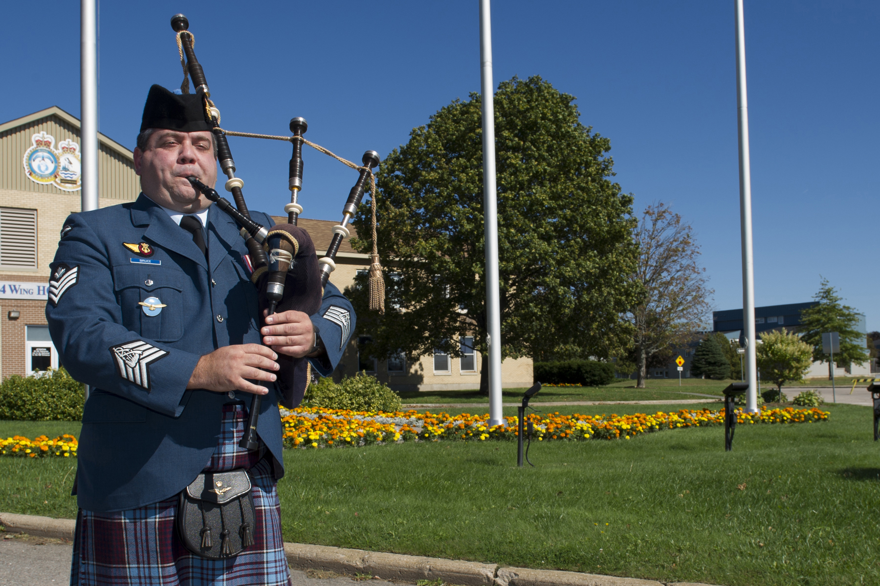 During the 2017 VPI memorial service held on October 1, 2017, at 14 Wing Greenwood, Nova Scotia, Sergeant Andrew Bruce of 14 Wing Pipes and Drums plays the Lament. PHOTO: Master Corporal Rory Wilson, GD14-2017-0602-004