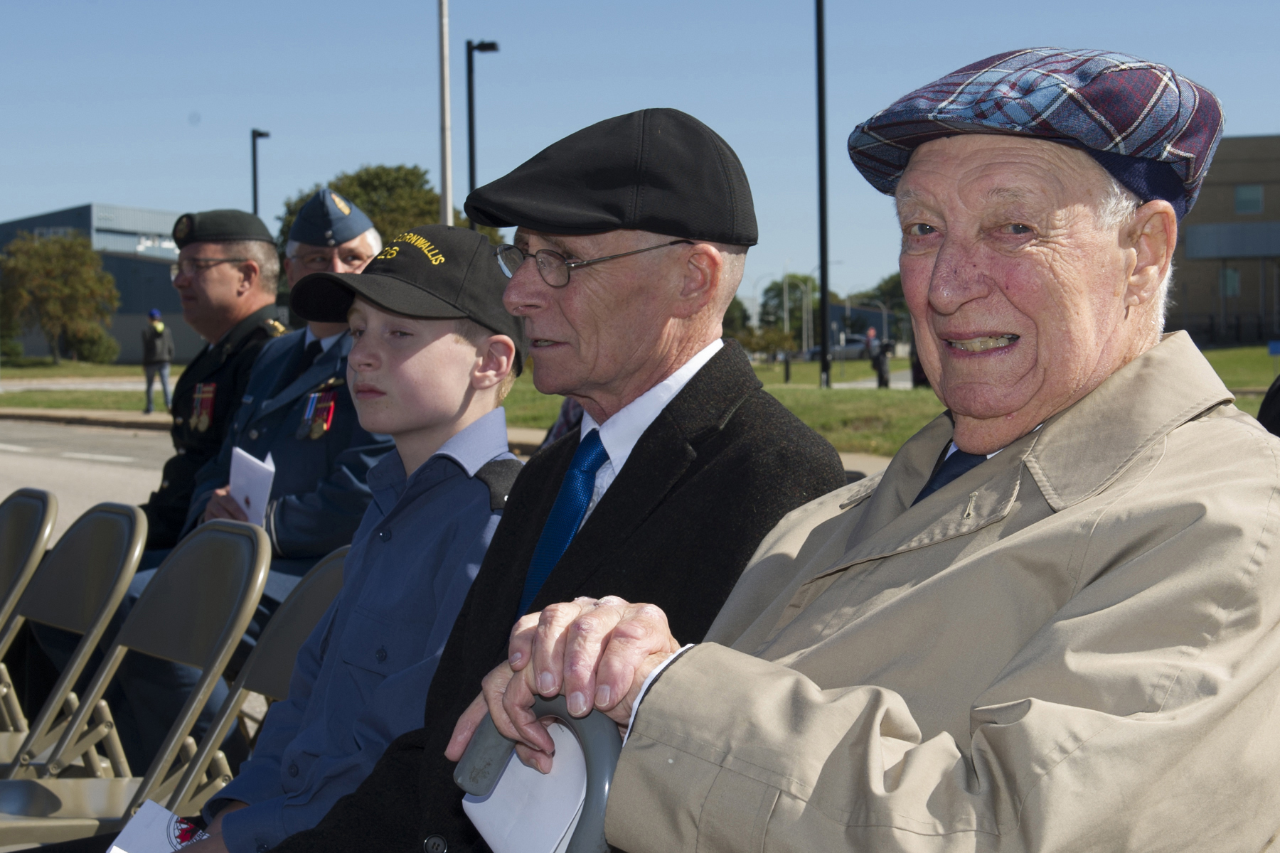 During the 2017 VPI memorial service held on October 1, 2017, at 14 Wing Greenwood, Nova Scotia, Colonel (retired) Herb Smale (foreground), founder of VP International and a former commander of 14 Wing, sits with his son, Pat (centre) and grandson Noah. PHOTO: Master Corporal Rory Wilson, GD14-2017-0602-001