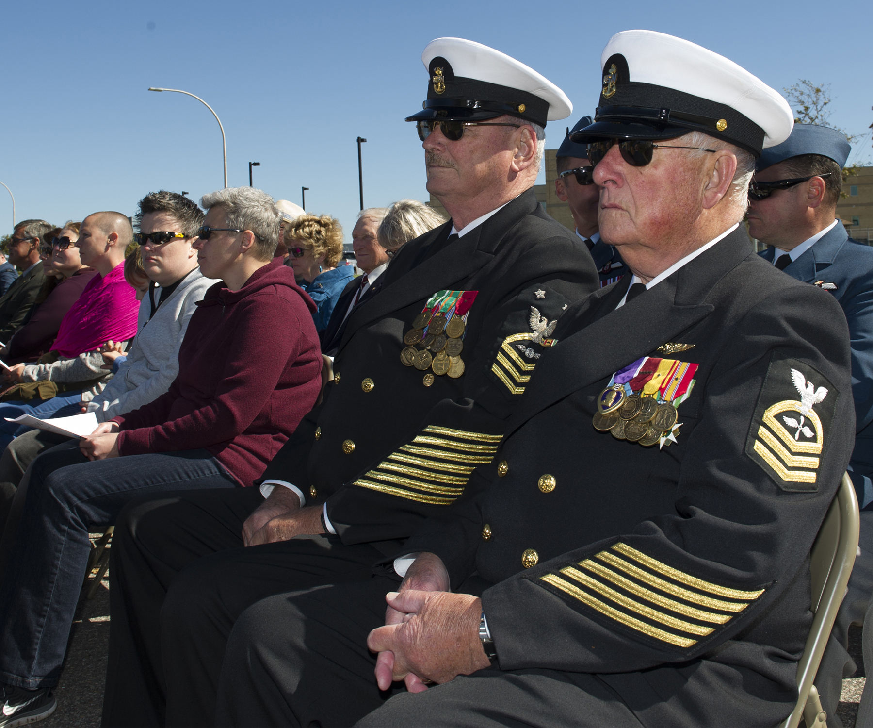 On October 1, 2017, United States Navy Reserves Chief Petty Offer Dan Sullivan (foreground) and United States Navy Master Chief Petty Officer Herb Parsons (left) attend the 2017 VPI memorial service held at 14 Wing Greenwood, Nova Scotia. PHOTO: Master Corporal Rory Wilson, GD14-2017-0602-007