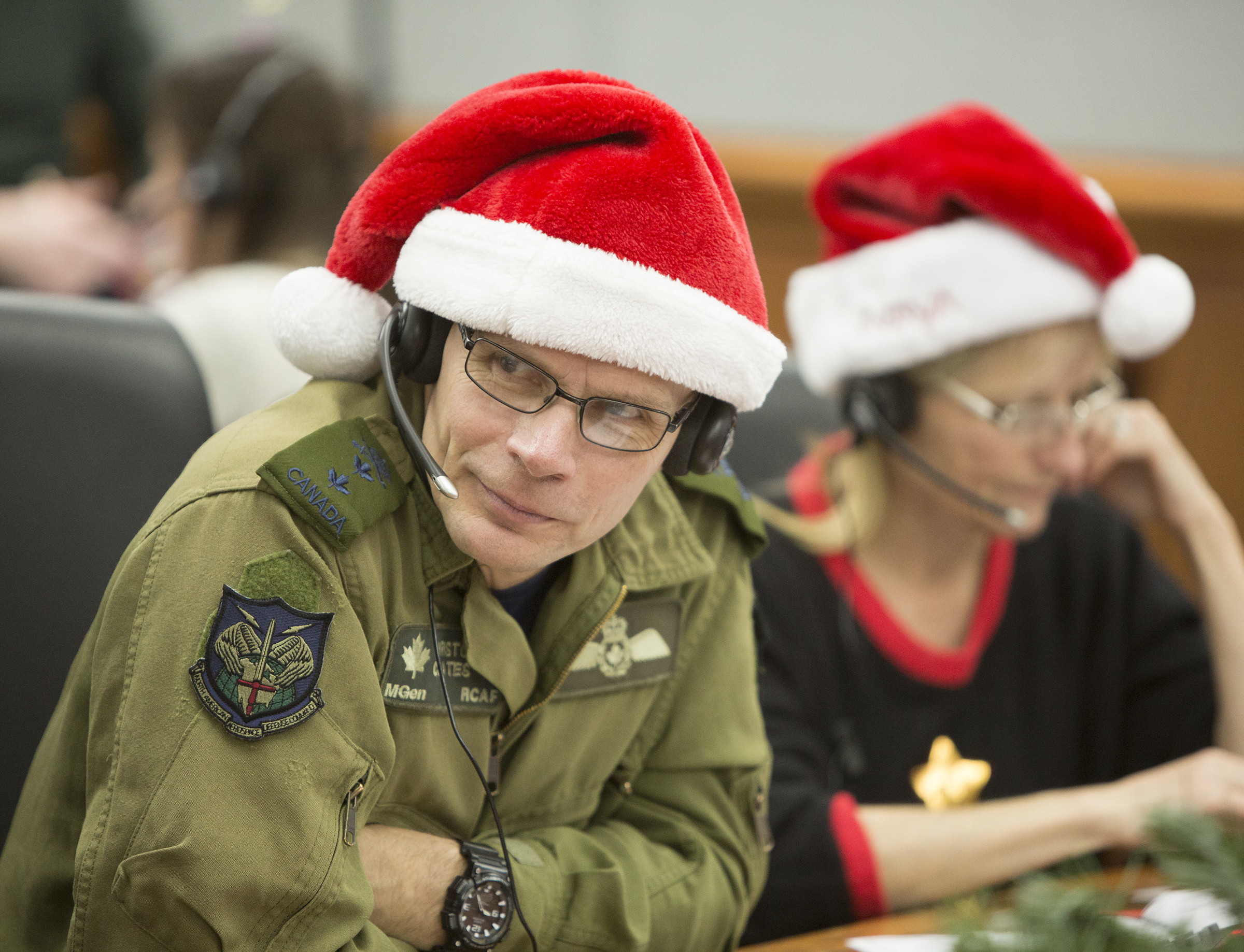 The Royal Canadian Air Force's Major-General Christopher Coates listens intently to a caller during the 2016 NORAD Tracks Santa Event at Peterson Air Force Base in Colorado on December 24. Major-General Coates is director of NORAD Operations at NORAD's binational headquarters at Peterson AFB. PHOTO: Dennis Carlyle, NORAD, 161224-F-CN249-400