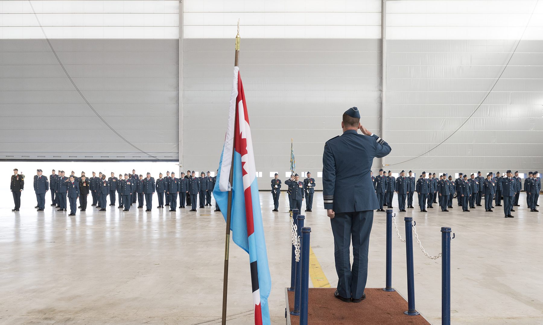 On November 7, 2017, Royal Canadian Air Force commander Lieutenant-General Michael Hood (foreground) returns a salute from members of 429 Transport Squadron during the squadron's 75th anniversary parade. PHOTO: Ordinary Seaman Paul Green, TN05-2017-0661-036