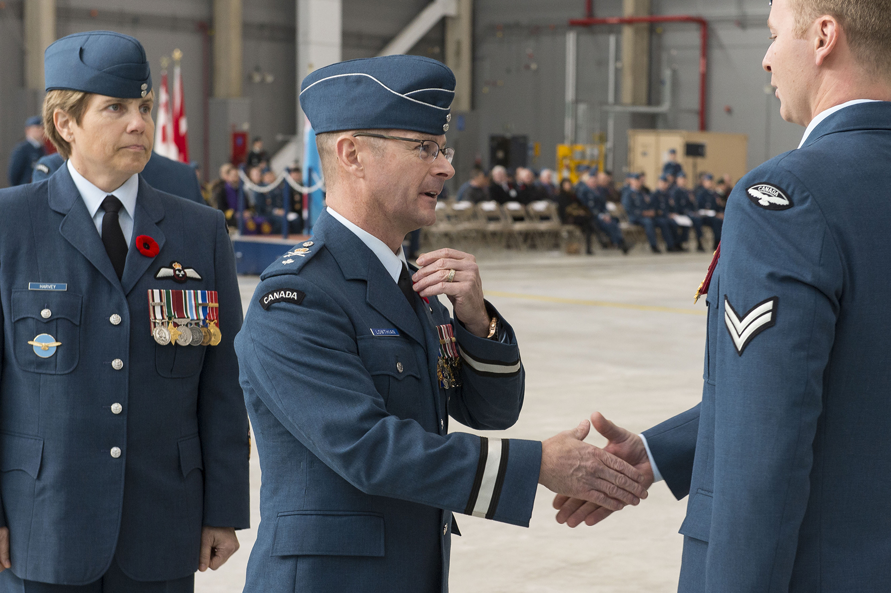 Brigadier-General David Lowthian greets Corporal Luke Summerfield during the parade held at 8 Wing Trenton, Ontario, on November 7, 2017, to mark the 75th anniversary of 429 Transport Squadron. PHOTO: Ordinary Seaman Paul Green, TN05-2017-0661-086