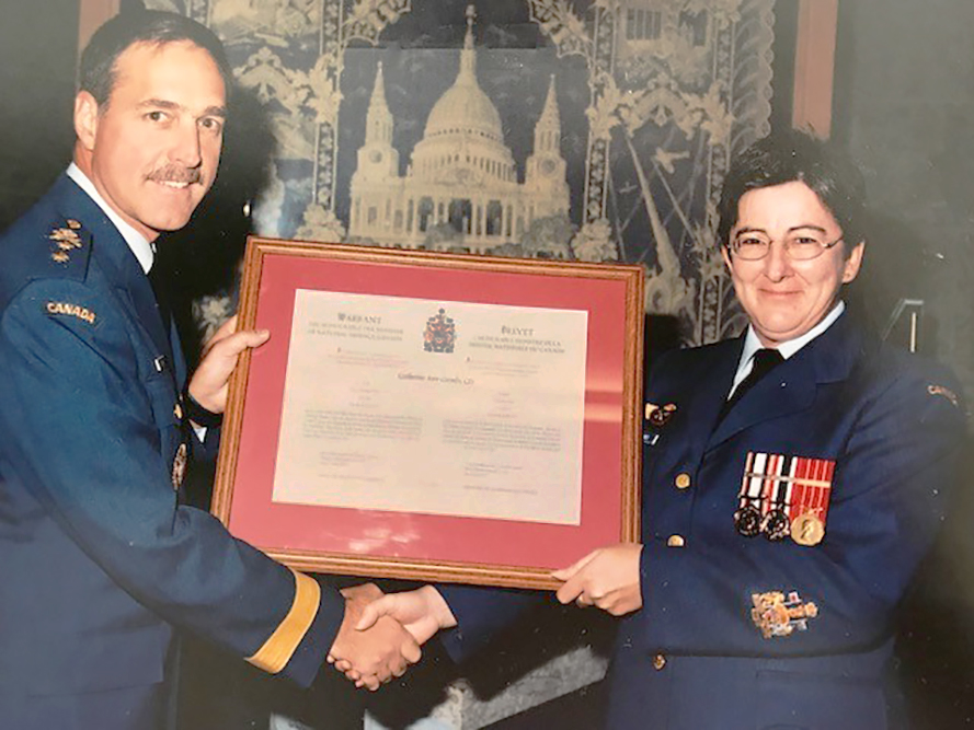 Chief Warrant Officer Cathy Coombs receives her Chief Warrant Officer's Scroll from Major-General Marc Dumais, then-commander of 1 Canadian Air Division. Chief Warrant Officer's Scrolls, signed by the Minister of National Defence, appoint recipients to be chief warrant officers and briefly outline their responsibilities. PHOTO: Submitted