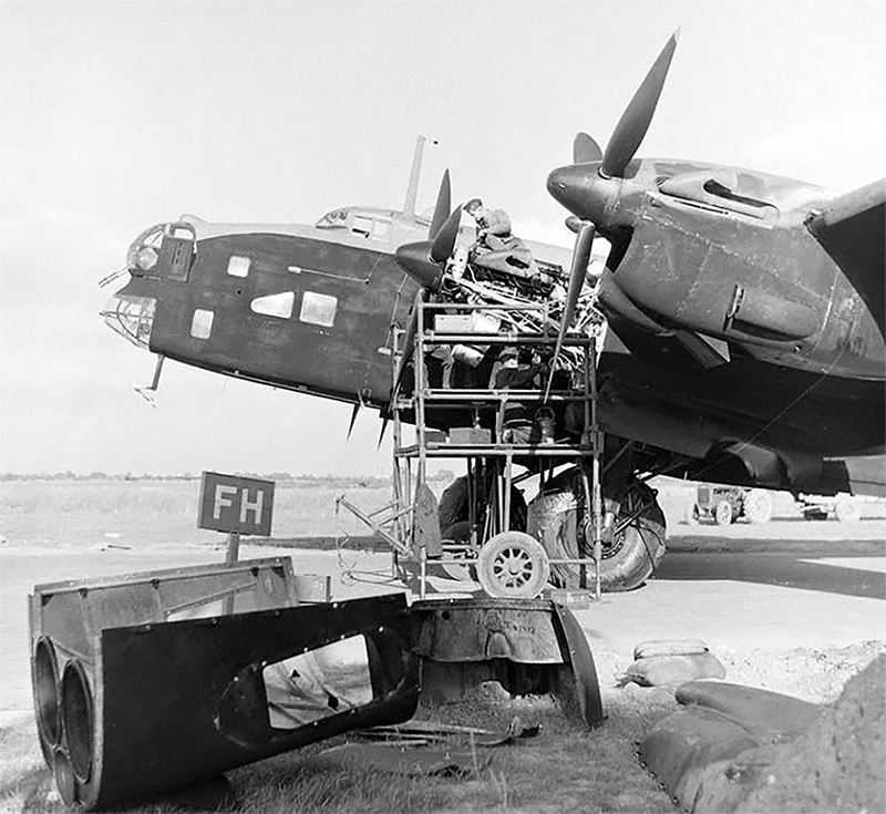 In an undated photograph, groundcrew members work on a Halifax heavy bomber in preparation for another raid over Germany. PHOTO: Royal Air Force