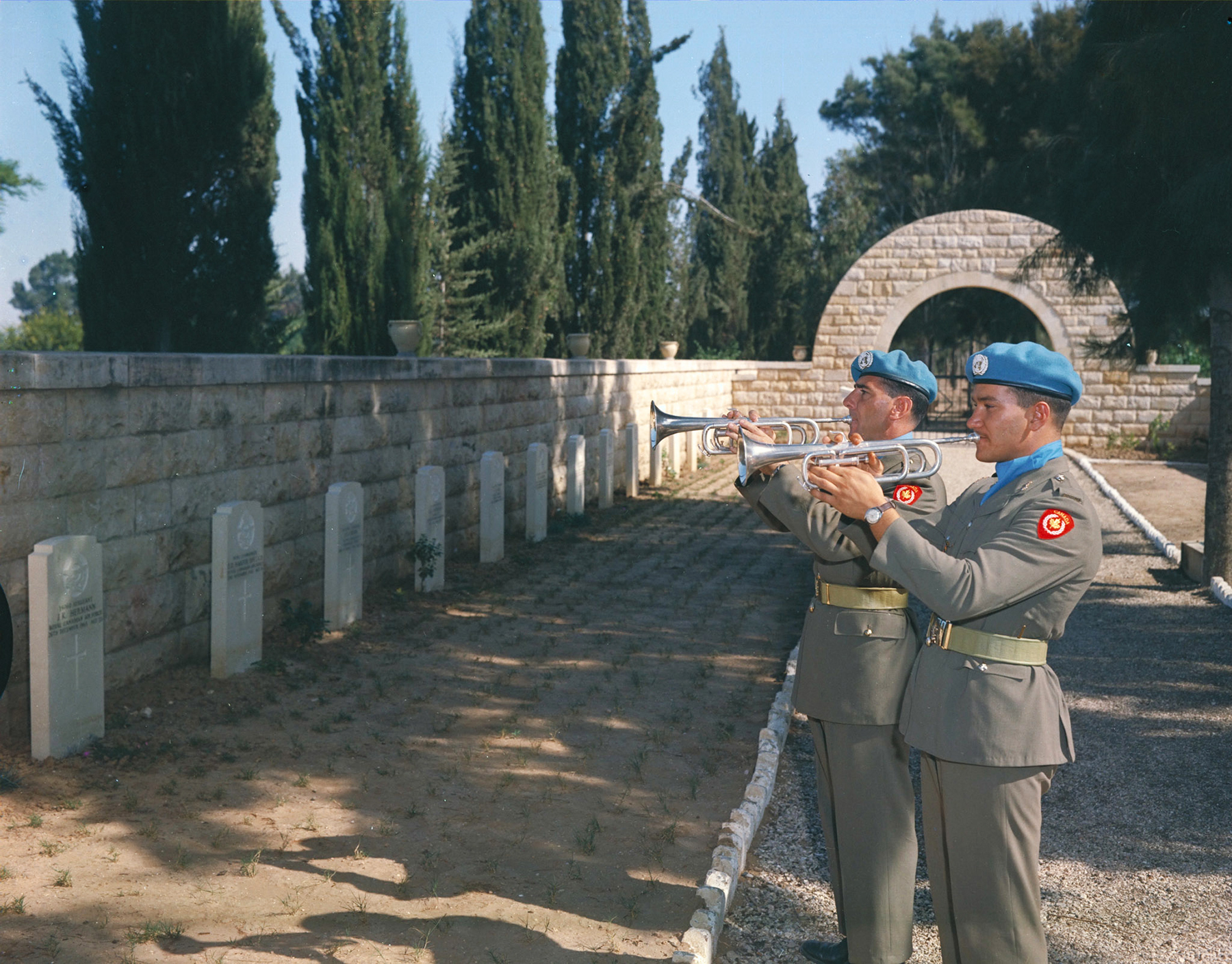 Trumpeters sound Last Post during a November 11, 1964, Remembrance Day ceremony in the Canadian Section of the British War Cemetery in Gaza, Palestine. PHOTO: DND Archives, ZK-2040-1